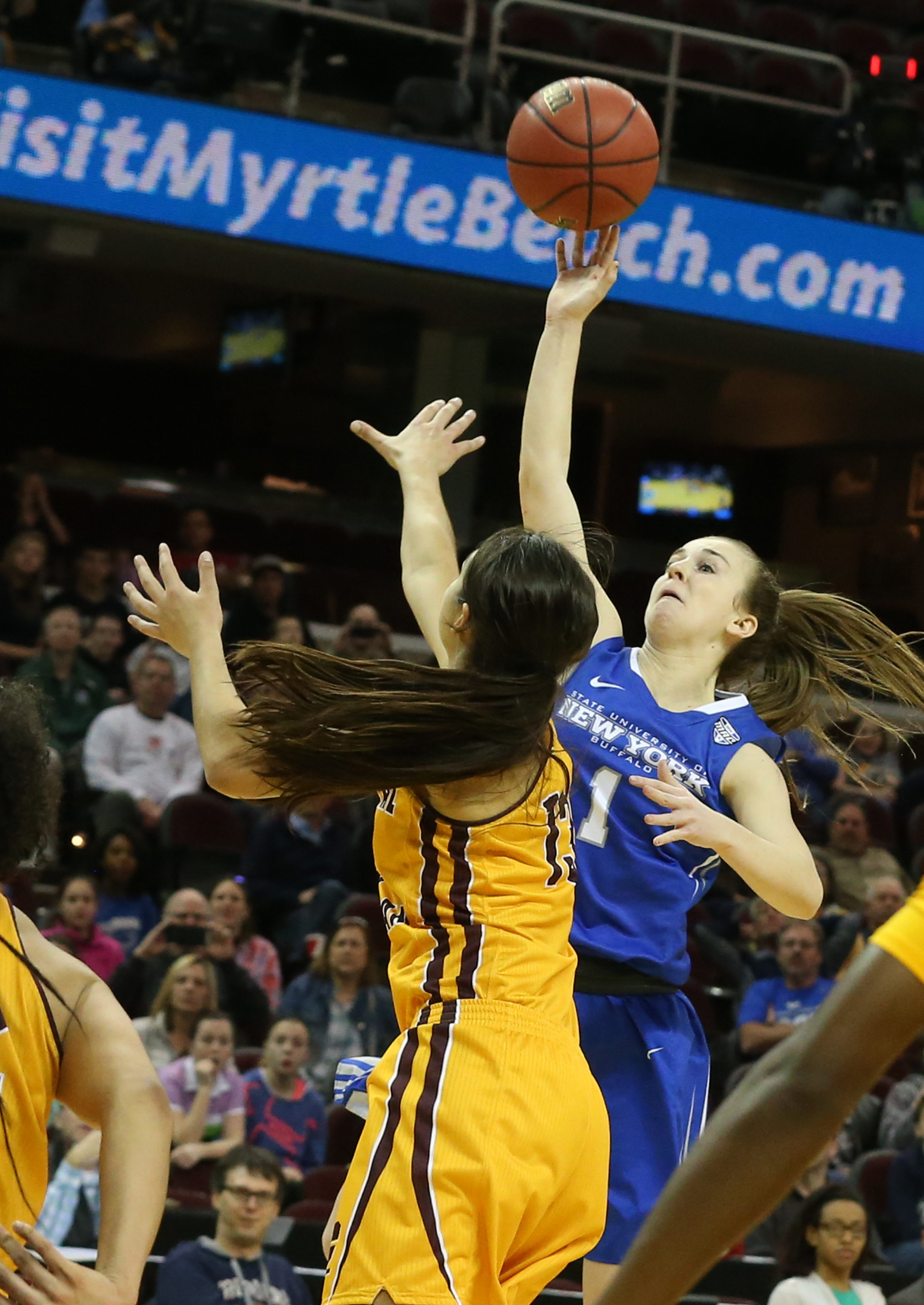 Buffalo Bulls guard Stephanie Reid (1) scores the game winning shot over Central Michigan Chippewas forward Reyna Frost (13) in the final second. The Buffalo Bulls beat Central Michigan 73-71 to win their first ever MAC Championship game at Quicken Loans Arena in Cleveland,NY on Saturday, March 12, 2016. (James P. McCoy/ Buffalo News)