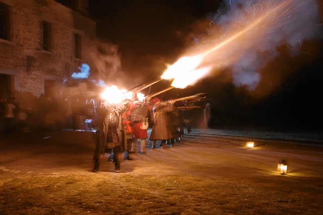 Re-enactors fire muskets at Old Fort Niagara. The fort will hold a 'Castle by Candlelight' event on Dec. 3 and Dec. 10, 2016. (Courtesy of Old Fort Niagara).