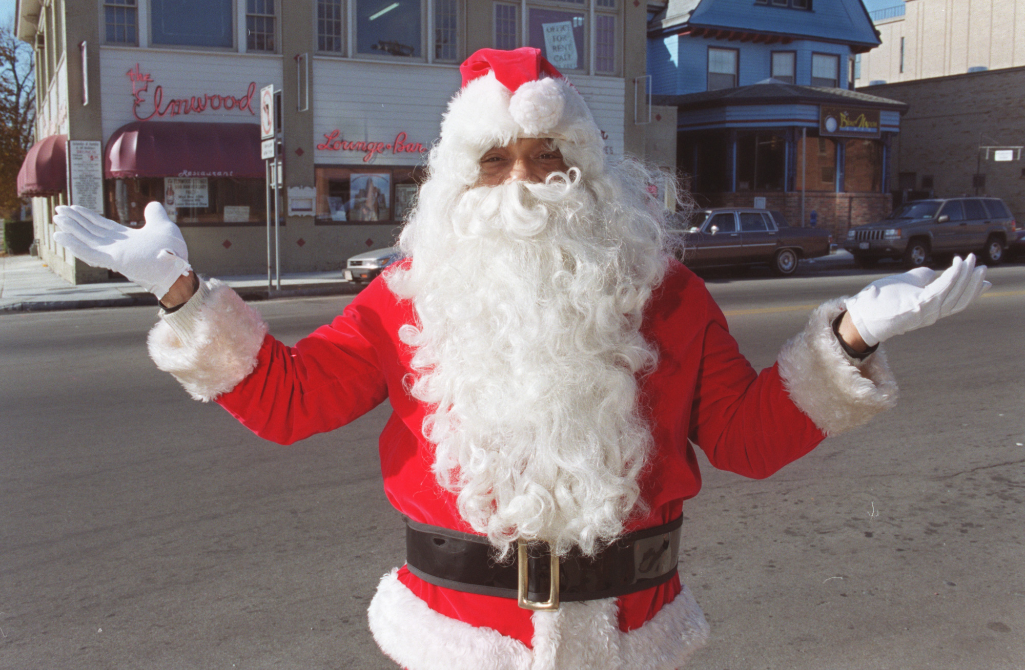 Santa Claus stands outside of the Elmwood Restaurant and Lounge during a past holiday season. (File photo by Charles Lewis)