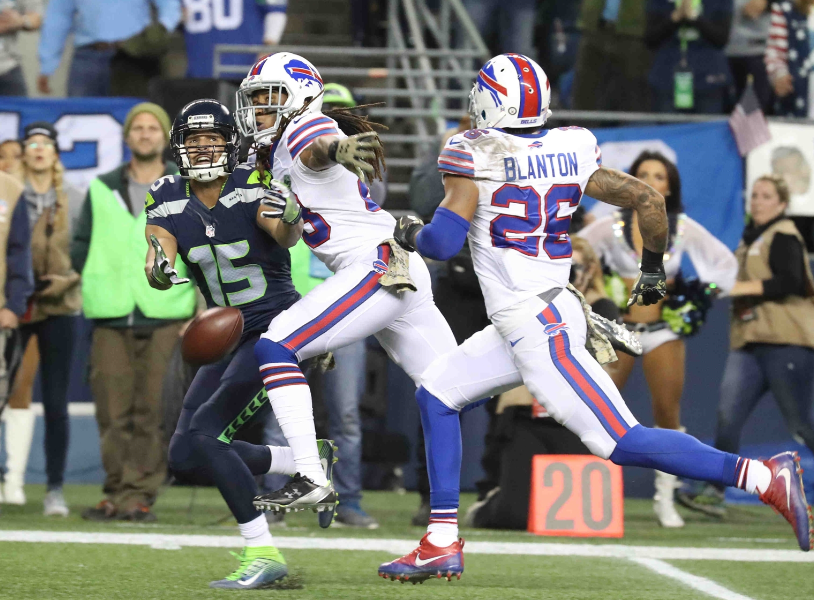 Bills defensive backs Ronald Darby (28) and Robert Blanton (26) defend Jermaine Kearse during the Seahakws game. (James P. McCoy/Buffalo News)