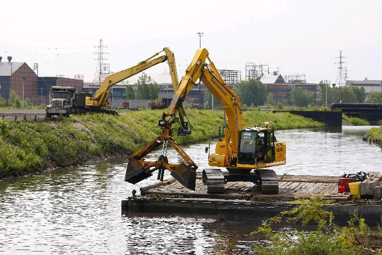 Heavy equipment is used to dredge Smokes Creek on the former Bethlehem Steel site in Lackawanna in this file photo from June 25, 2015. (Mark Mulville/Buffalo News)
