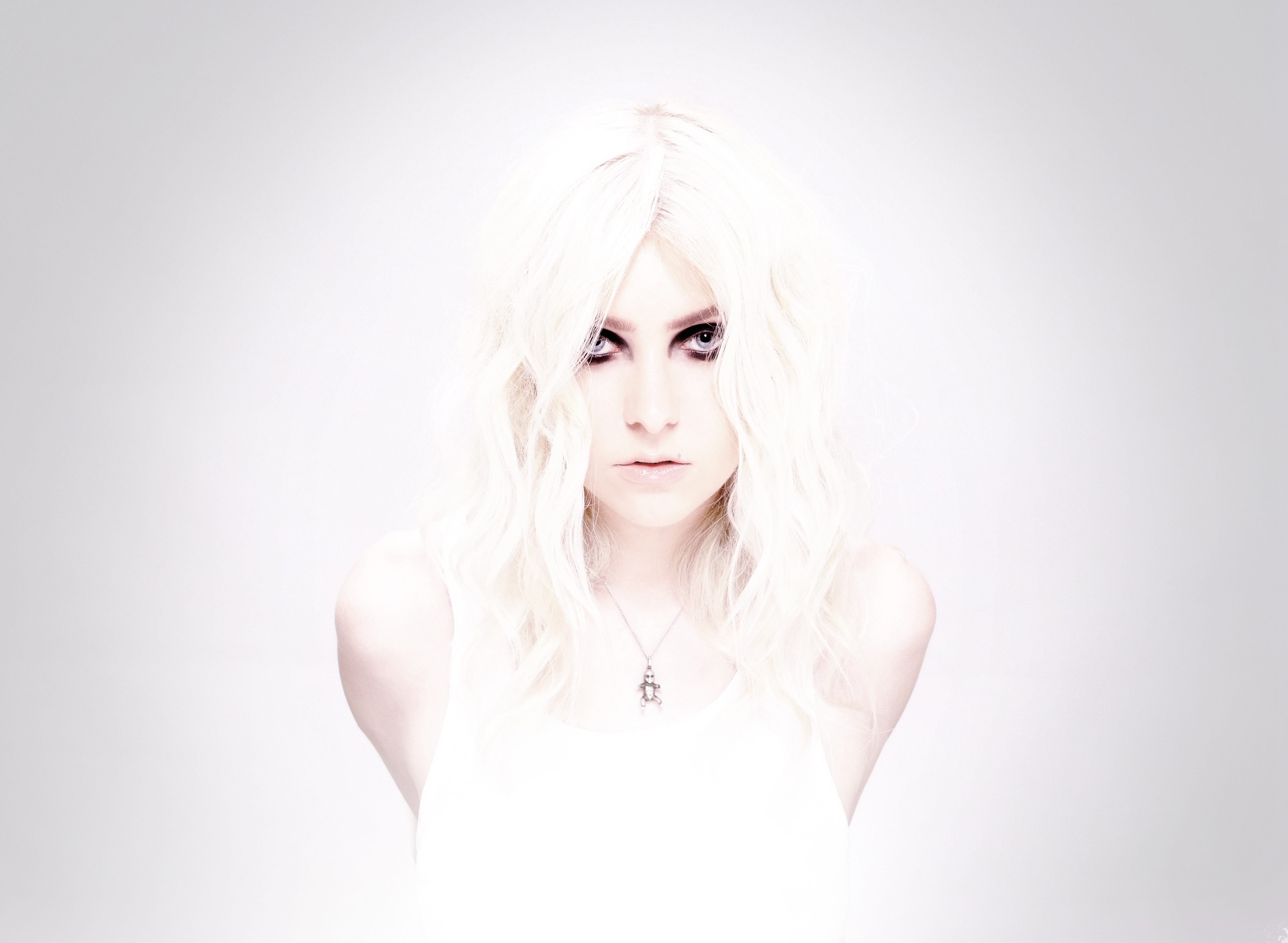 Writing is 'tortuous' but therapeutic process for Taylor Momsen, front woman of The Pretty Reckless.