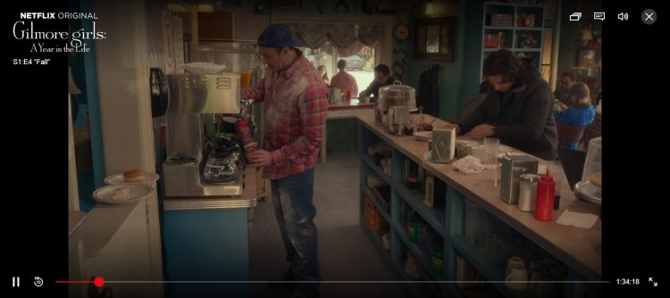 A screenshot of a still on Netflix which shows Luke (Scott Patterson) brewing Tim Horton's coffee.