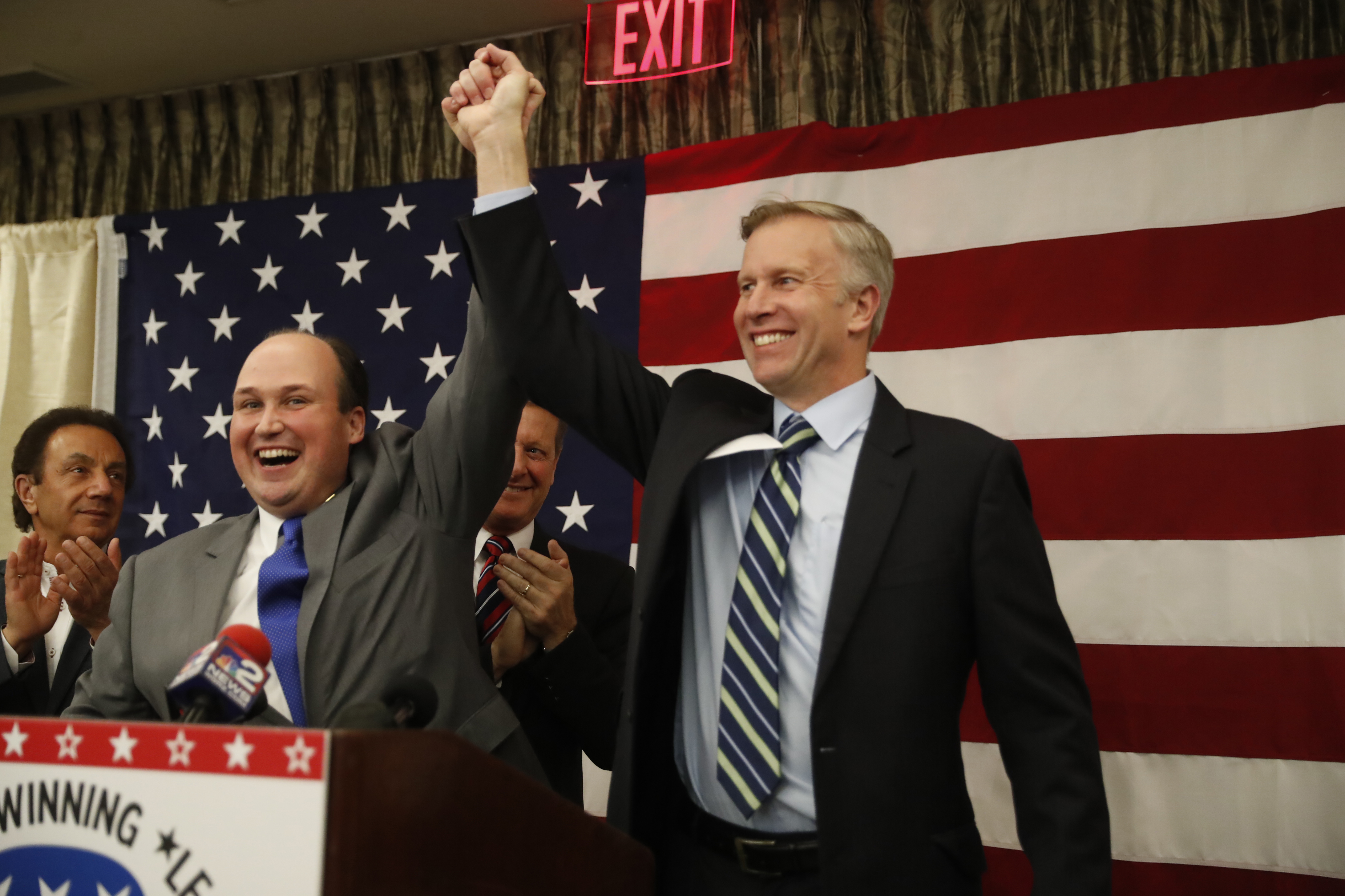 Erie County Republican Committee Chairman Nick Langworthy raises Chris Jacobs' arm in victory after Jacobs was declared the winner in the 60th District State Senate race. (Harry Scull Jr./Buffalo News)