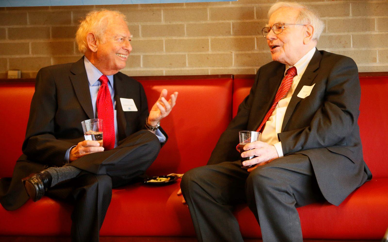 Stan Lipsey, left, and Warren Buffett share a laugh in 2013. (Derek Gee/Buffalo News)