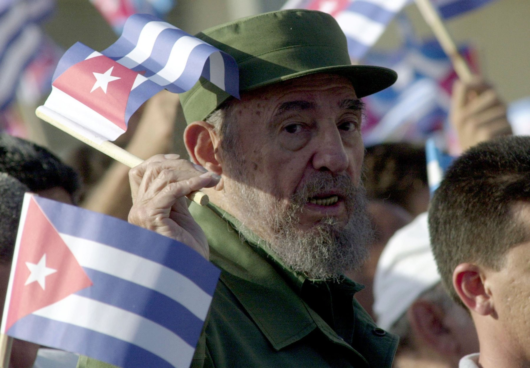Cuban President Fidel Castro waves a Cuban flag during a demonstration outside the U.S. Interest Section June 21, 2004, in Havana, Cuba. The former leader of Cuba died Friday at the age of 90.  (Getty Images)