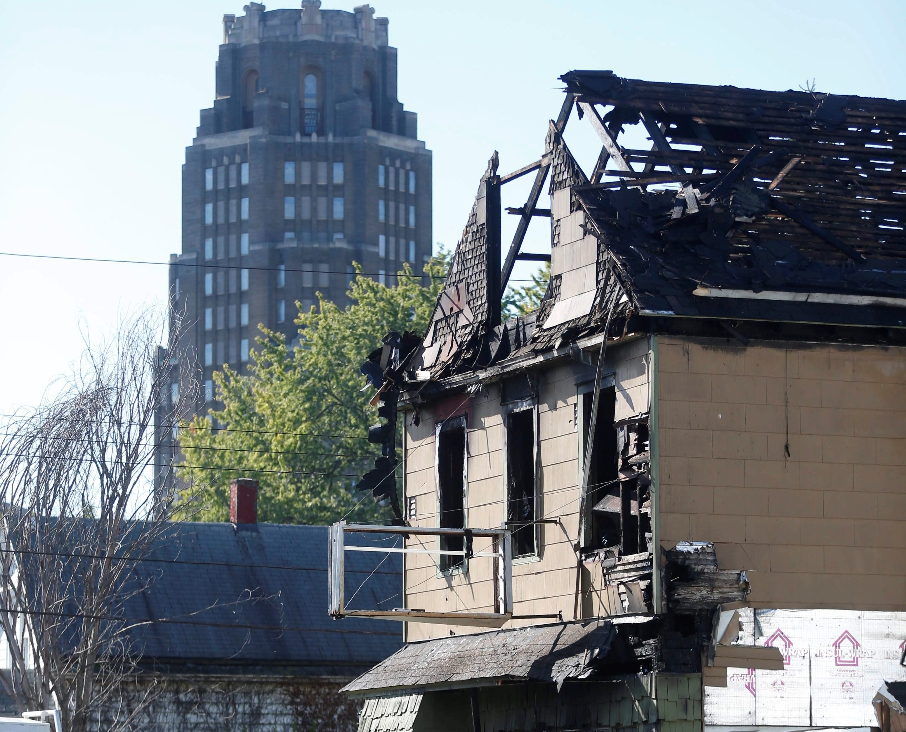 The scene of the fire at a rooming house on Curtiss Street where two men died in October. (Robert Kirkham/News file photo)