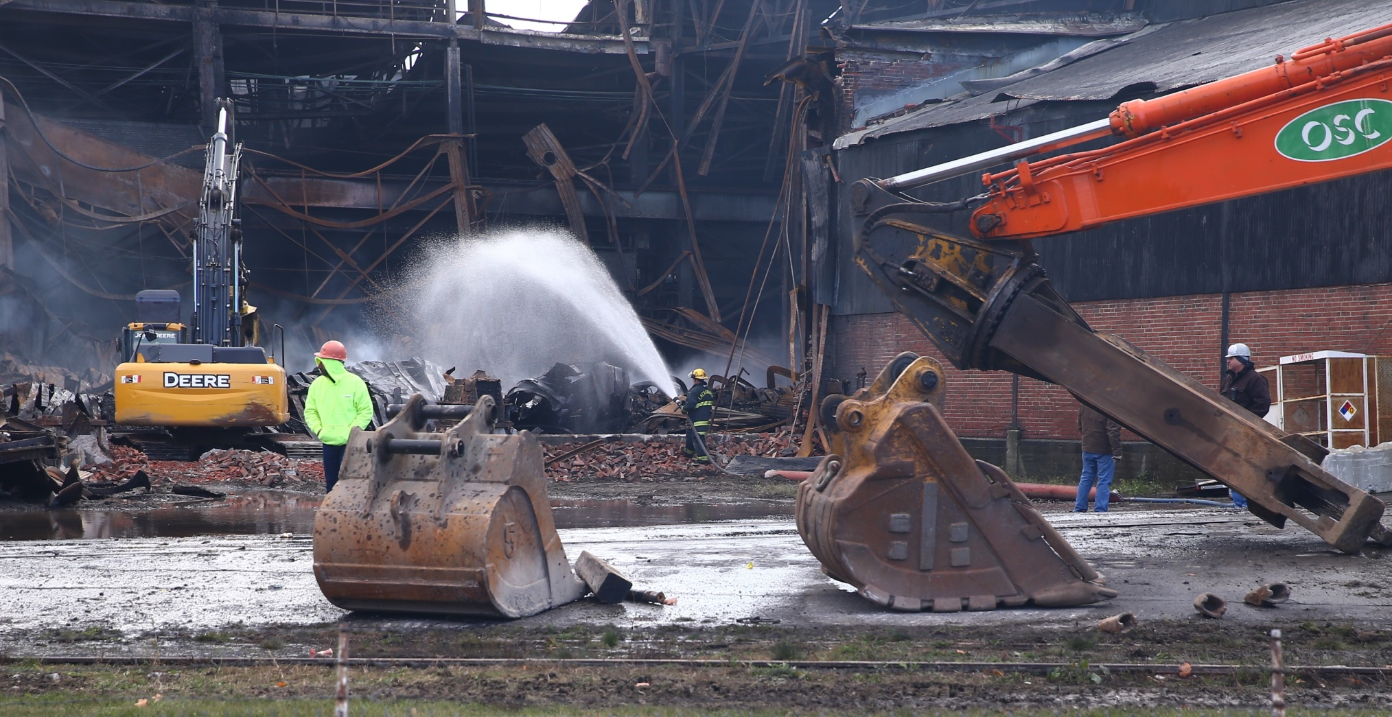Crews work on putting out hot spots after demolition work on Friday, Nov. 11, 2016. (John Hickey/Buffalo News)