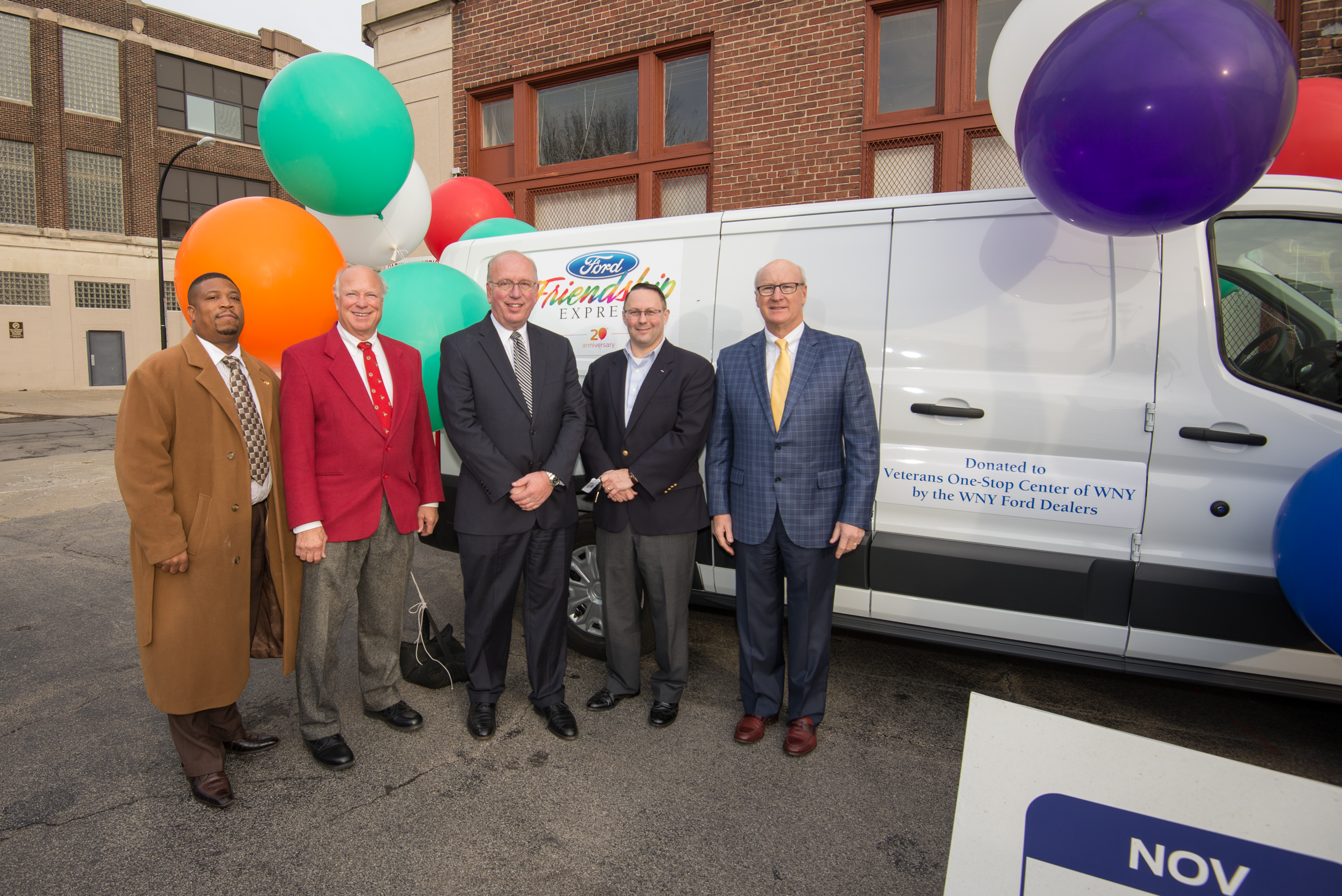 One of three vans donated through Ford Friendship Express. Left to right: Kenny Simmons, director of recreation, City of Buffalo; Carl Emmerling, Ford Friendship Express selection committee member; Scott Bieler, chairman of selection committee; Roger Woodworth, president and CEO, Veterans One-stop; Chuck Basil, Basil Ford.