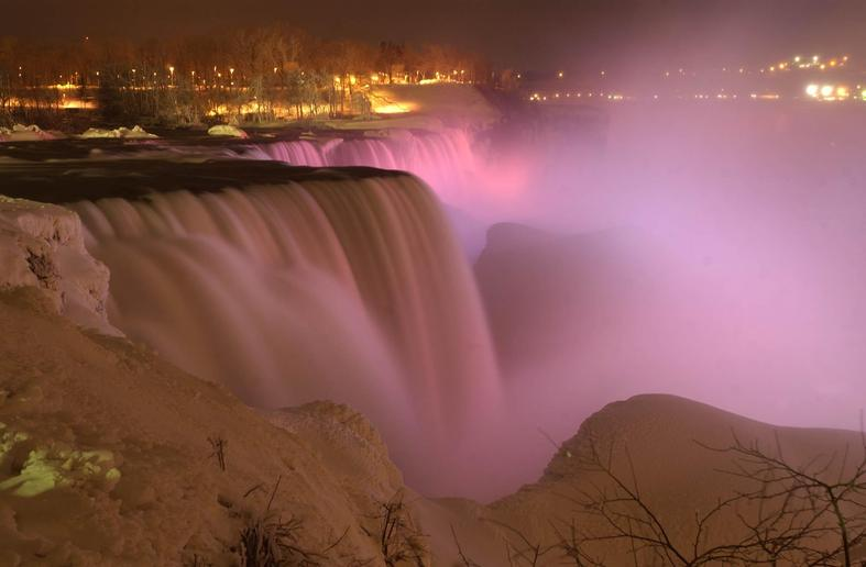 Niagara Falls is lit by purple, blue and yellow in honor of the Alzheimer's Association and the Canadian Alzheimer's Society. (Derek Gee/Buffalo News)