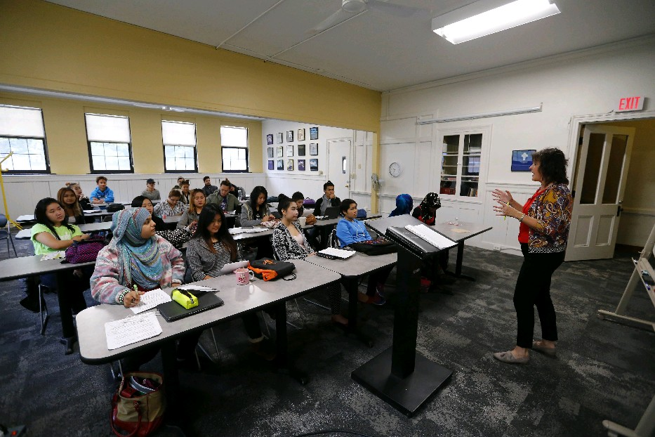 Denise Reichard teaches a communications class at Houghton College at the First Presbyterian Church in Buffalo. Mark Mulville/Buffalo News)