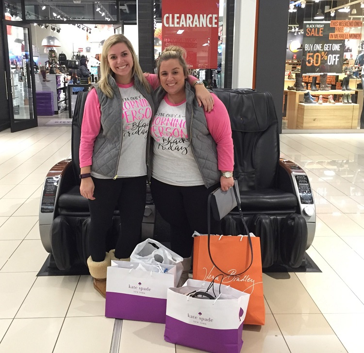 "Claire Whieldon of Philadelphia, originally from Orchard Park, at left, and Kelly Jantzi of Hamburg wore matching shirts to shop on Black Friday: ""I'm only a morning person on Black Friday."" (Aaron Besecker/Buffalo News)"