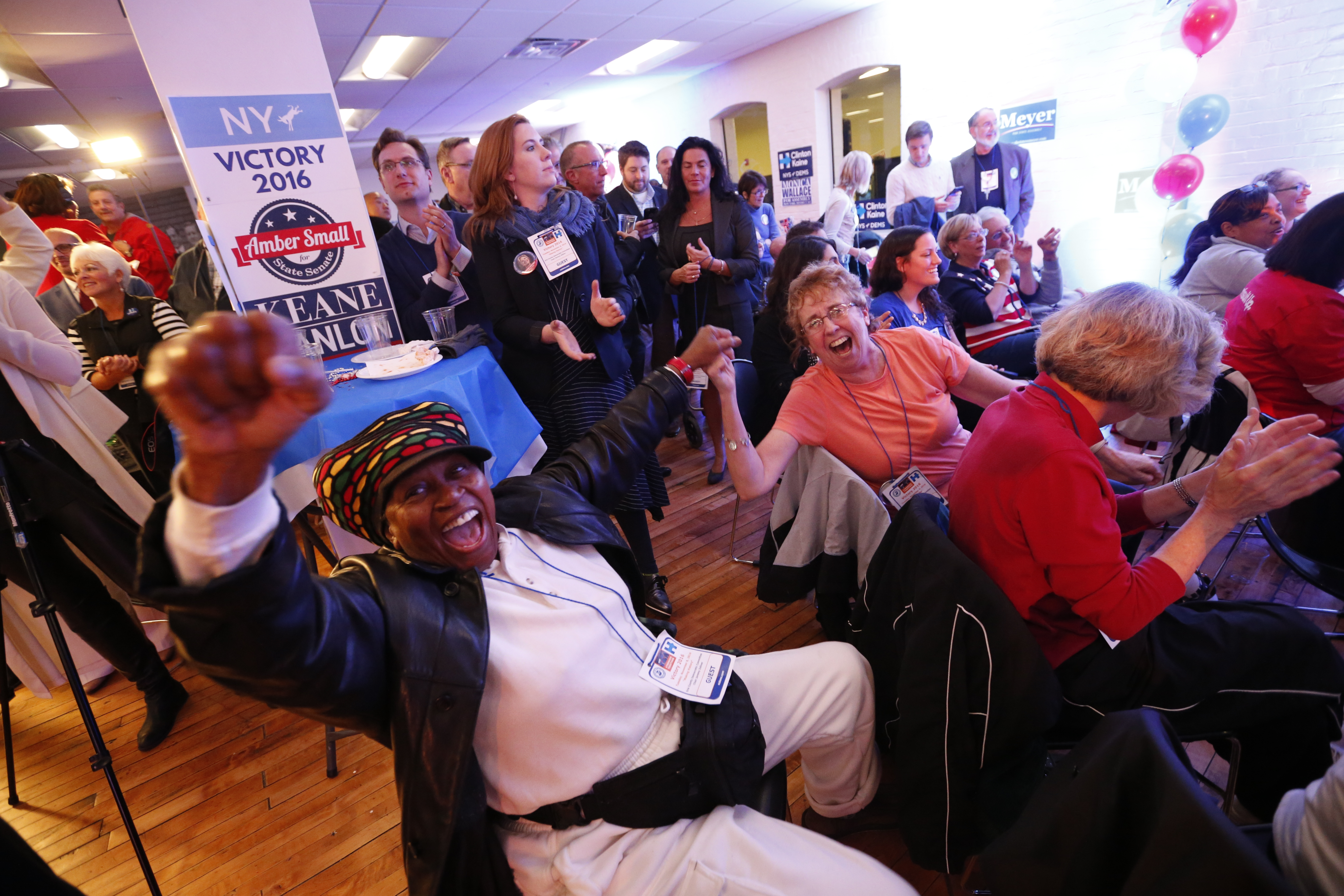 Louise Gullate, of Niagara Falls, celebrates Hillary Clinton winning California during the Erie County Democratic Party election night event at Larkinville on Tuesday, Nov. 8, 2016.  (Derek Gee/Buffalo News)