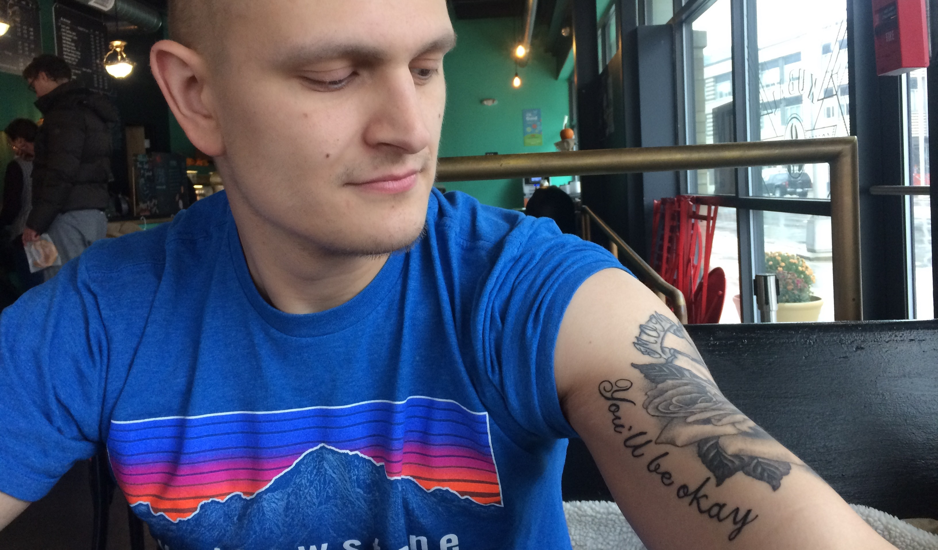 Michael Feldman, at the Cafe Kubal coffee shop in Syracuse, with a tattoo of his mother's last words: 'You'll be okay.' (Sean Kirst/submitted image)