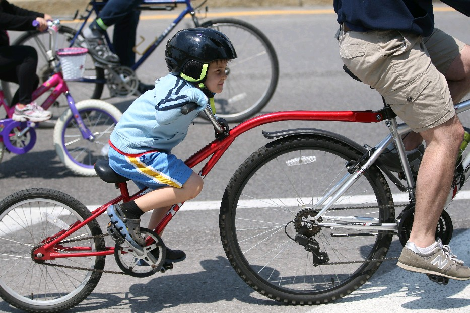 Kids ride up front during Slow Rolls with support from the group's lead team. (Sharon Cantillon/Buffalo News)