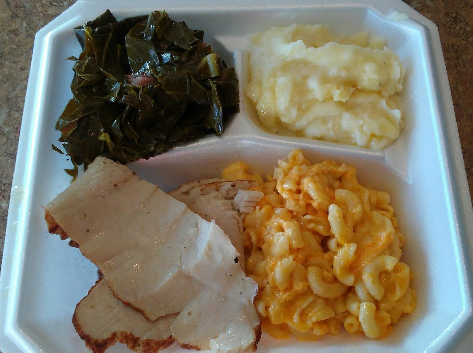 Dinners at Soulos Cafe come with two classic soul food sides, like the macaroni and cheese and collard greens with the sliced turkey. (Photo: Soulos Cafe)