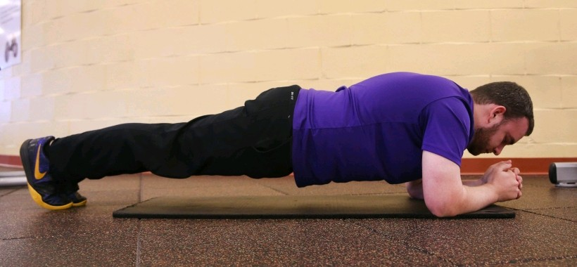 Make a plank harder by lifting one foot.