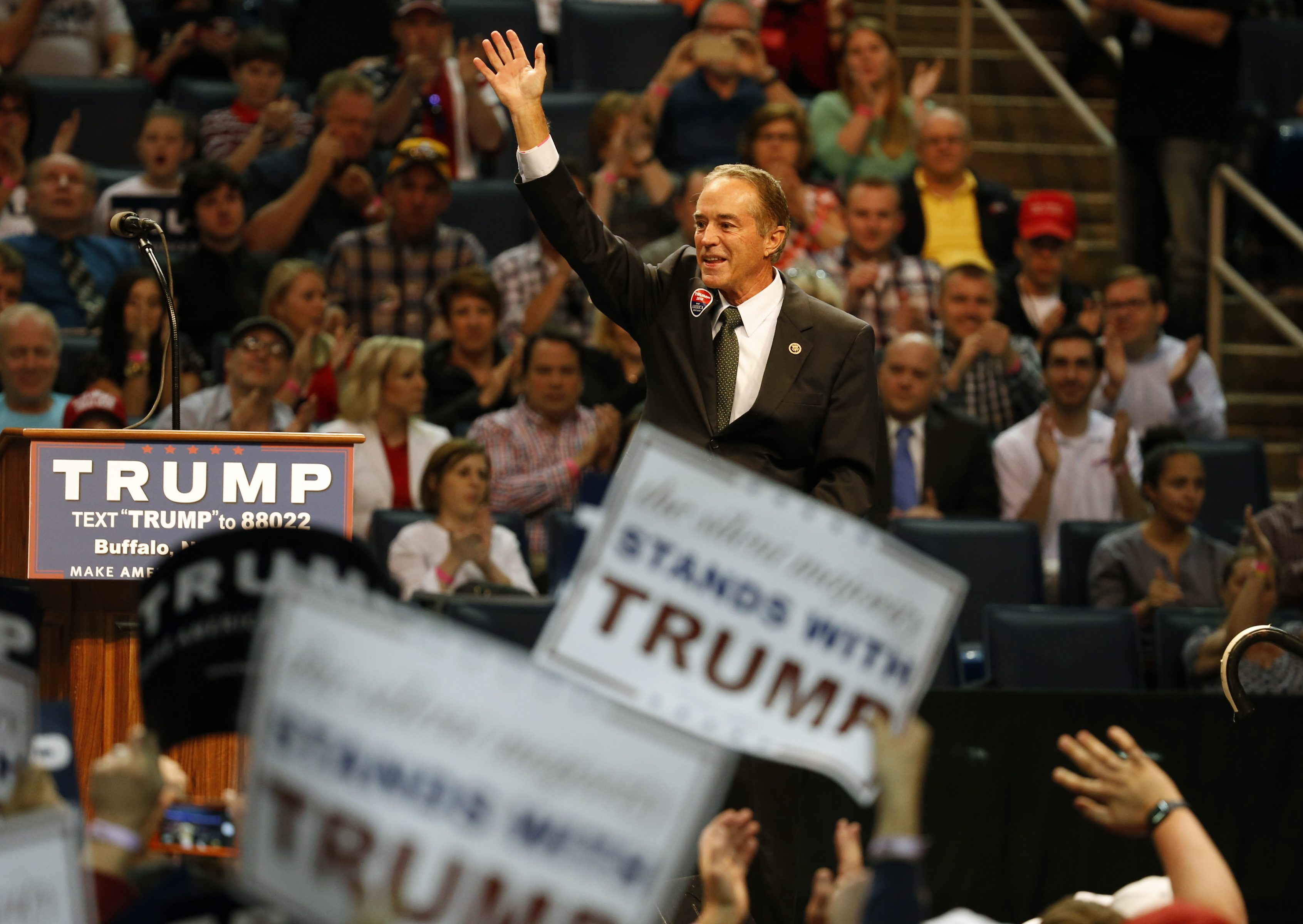 Congressman Chris Collins waives and speaks to the crowd gathered for now President-elect Donald Trump at the First Niagara Center during a rally in April. (Harry Scull Jr./Buffalo News)