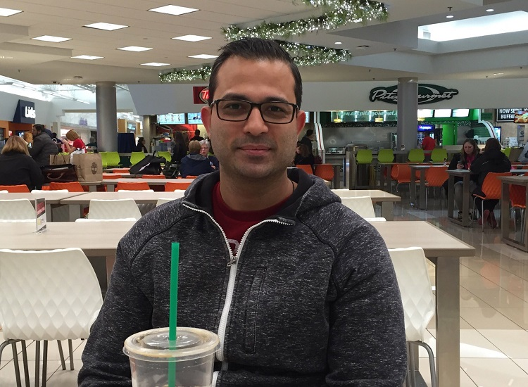 Vishal Bhushan, who lives in Vancouver but whose family is from Toronto, was shopping Friday with his father and sister. (Aaron Besecker/Buffalo News)
