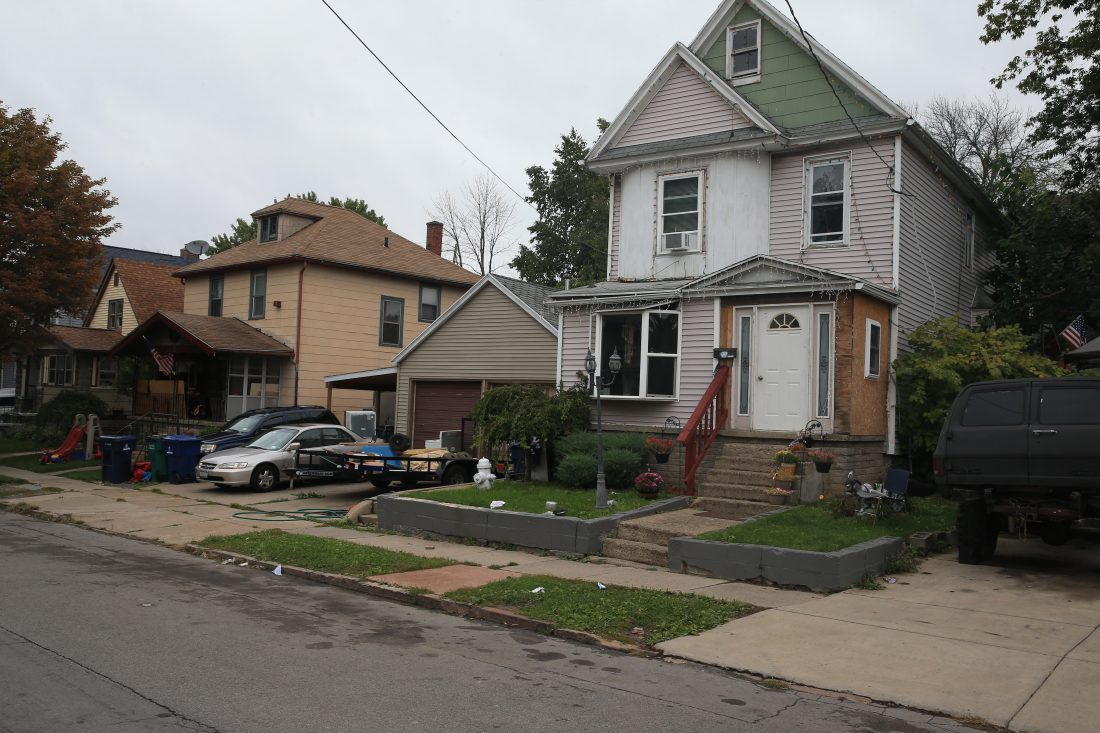 Some property owners who paid their Buffalo city taxes to avoid foreclosure didn't pay their county tax bills for years and – until recently – the county didn't threaten any city property with foreclosure. Homes like these on Hawley Street had unpaid county property taxes stretching back more than a decade. (John Hickey/Buffalo News)