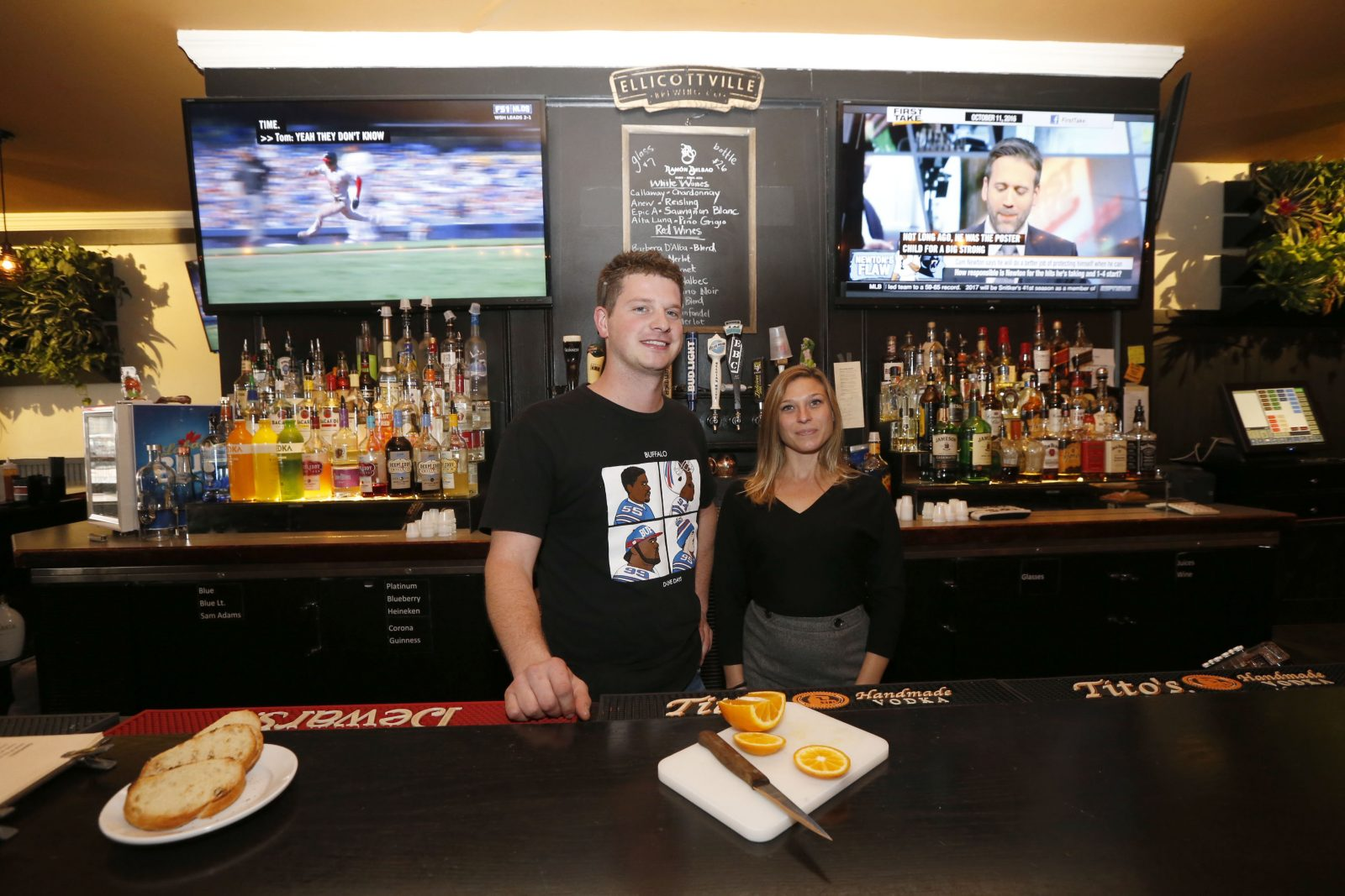 There are plenty of spots to see the game at the Jake Tavern and Grill in Kenmore, including the big-screen televisions behind the bar. Pictured are head bartender Peter Duggan and front-end manager Marcie Mascle. (Robert  Kirkham/Buffalo News)