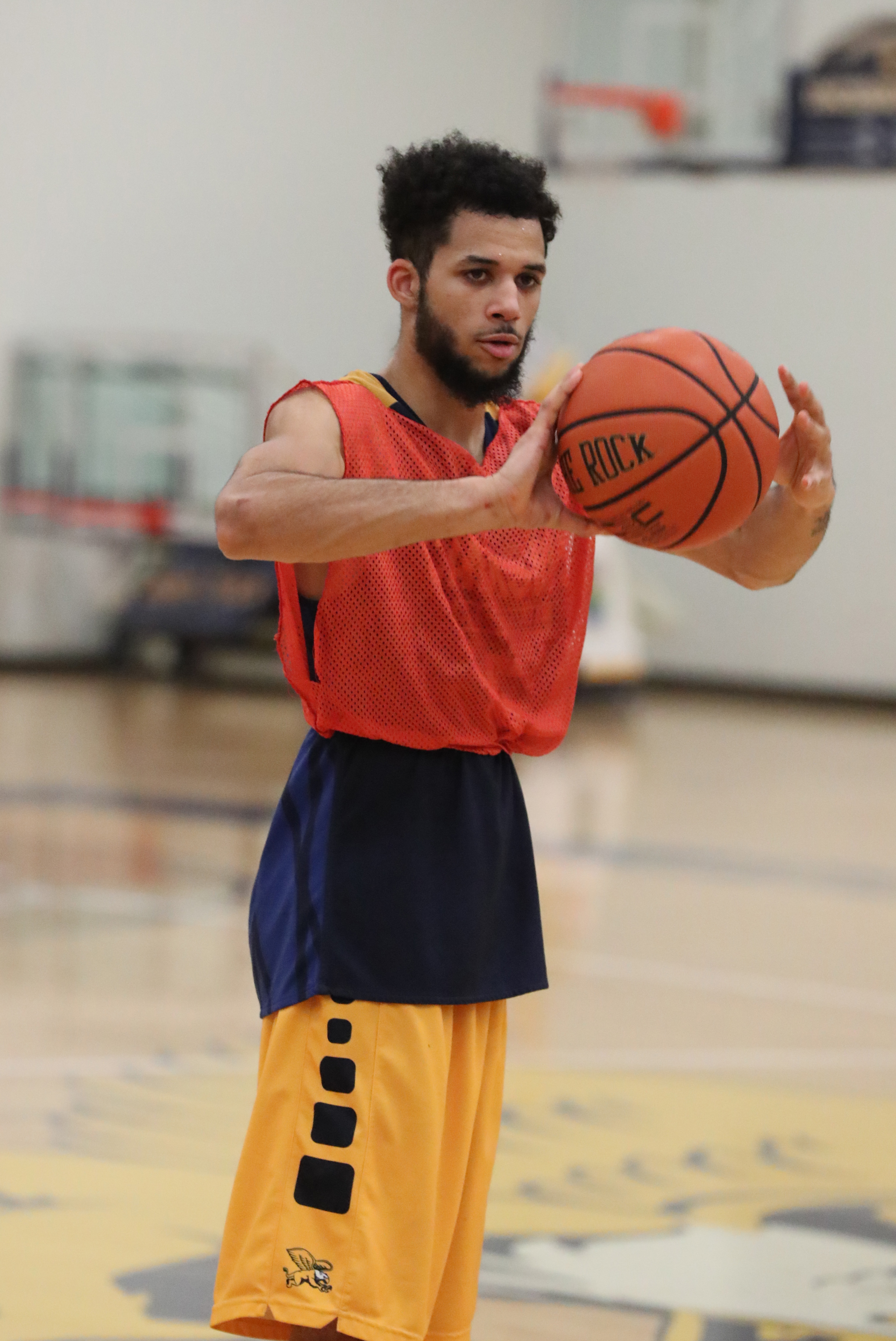 Kassius Robertson and the Golden Griffins are playing unselfishly under Reggie Witherspoon. (James P. McCoy/Buffalo News)