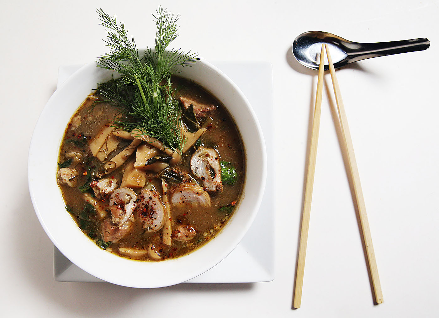 Kaydara Noodle Bar at 777 Main St. in Buffalo, serves bamboo stew. It's a seasonal special. It's made with pork, bamboo, dill, chilies, collard greens, beech mushrooms, pork chitterling and spinach. Photo taken, Wednesday, Nov. 16, 2016. (Sharon Cantillon/Buffalo News)