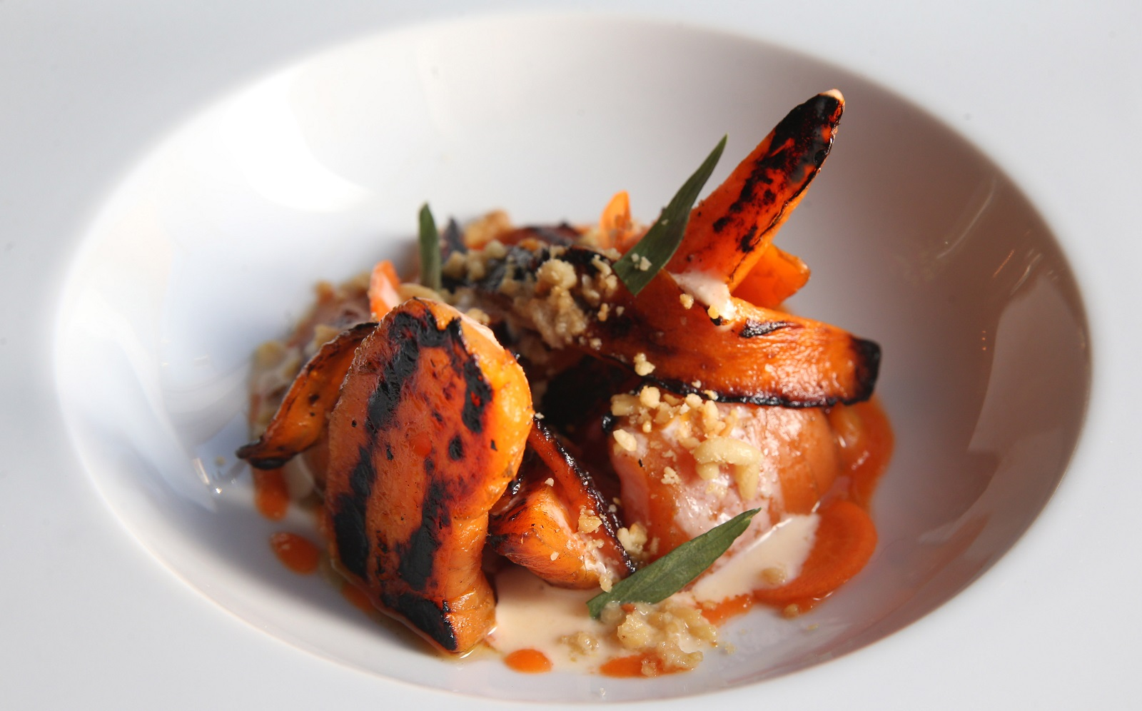 Carte Blanche's roasted carrot salad is made with charred carrots, carrot yogurt, spruce oil and pine nuts. (Sharon Cantillon/Buffalo News)