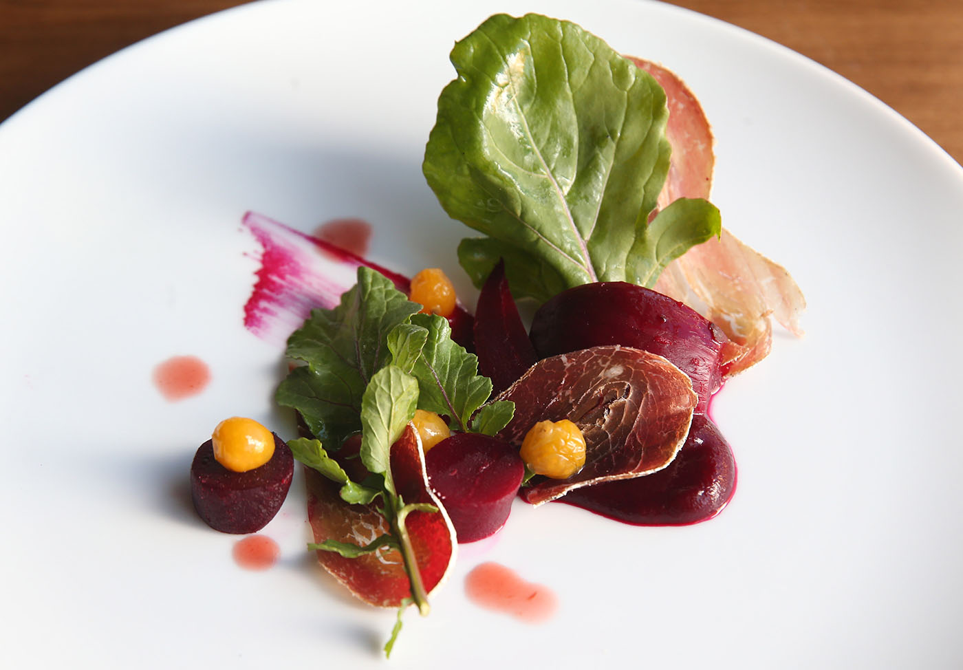 Carte Blanche is at 61 Buffalo St. in Hamburg. The beet salad is made with beet pudding, bresaola, pickled Inca berry and housemade plum vinegar. Photo taken, Friday, Nov. 18, 2016. (Sharon Cantillon/Buffalo News)