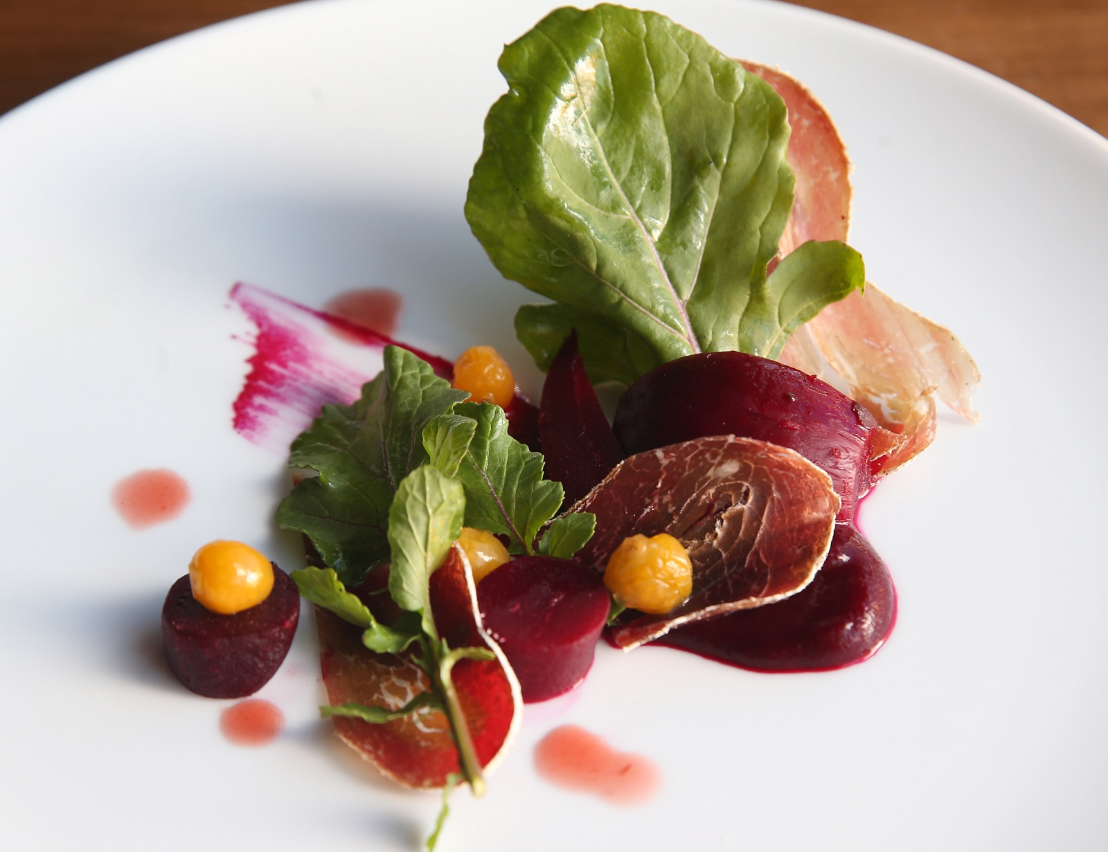 The beet salad is made with beet pudding, bresaola, pickled Inca berry and housemade plum vinegar. (Sharon Cantillon/Buffalo News)