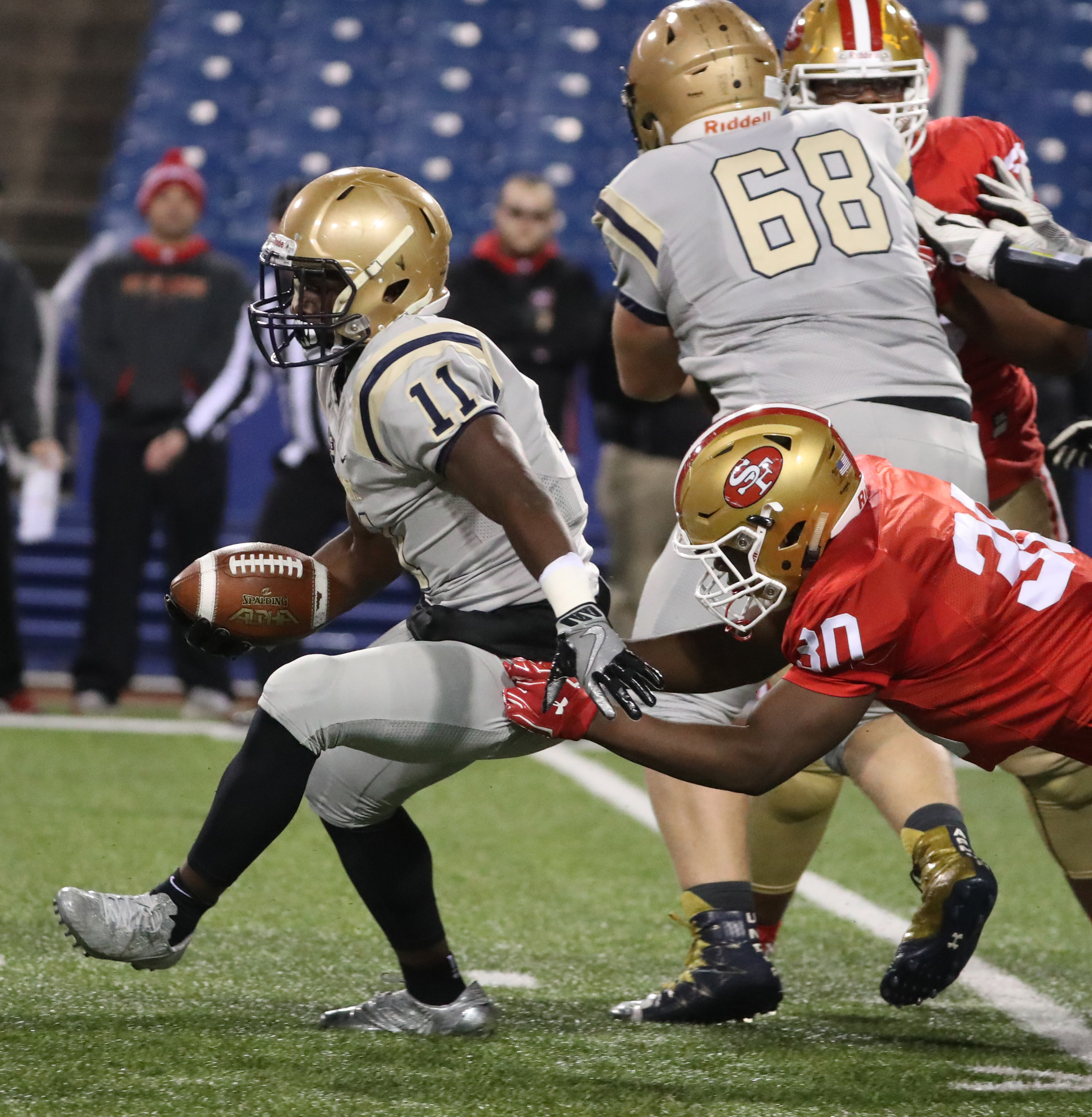 RaeQwon Greer rushed for two touchdowns and made an interception during Canisius' Monsignor Martin High School Athletic Association championship game win over St. Francis on Nov. 17.  (James P. McCoy/Buffalo News)