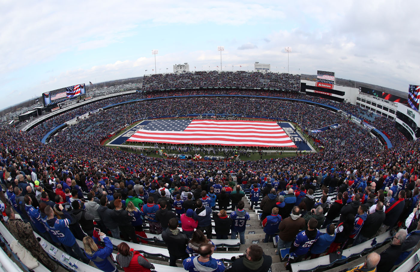 The U.S. flag fills New Era Field for a salute to the military before the beginning of the game.  (James P. McCoy/Buffalo News)