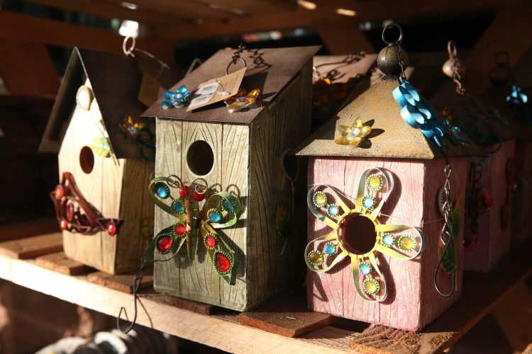 Creative birdhouses are some of the gifts available at Niagara Produce where you can also purchase Christmas trees and wreaths. (Sharon Cantillon/Buffalo News)