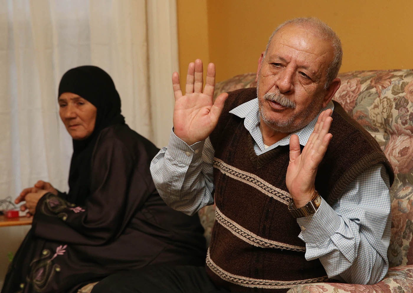 The Ay Toghlo family, refugees from Syria, are now residents on Buffalo's West side. Photo taken in their home, Wednesday, Nov. 23, 2016. From left are Eidah Al Suleiman, 54, her husband Mohammed Ay Toghlo, 67. They talk about how they came to the United States and how happy they are to be here. Husband and wife arrived on August 24 and their son arrived on September 21. (Sharon Cantillon/Buffalo News)