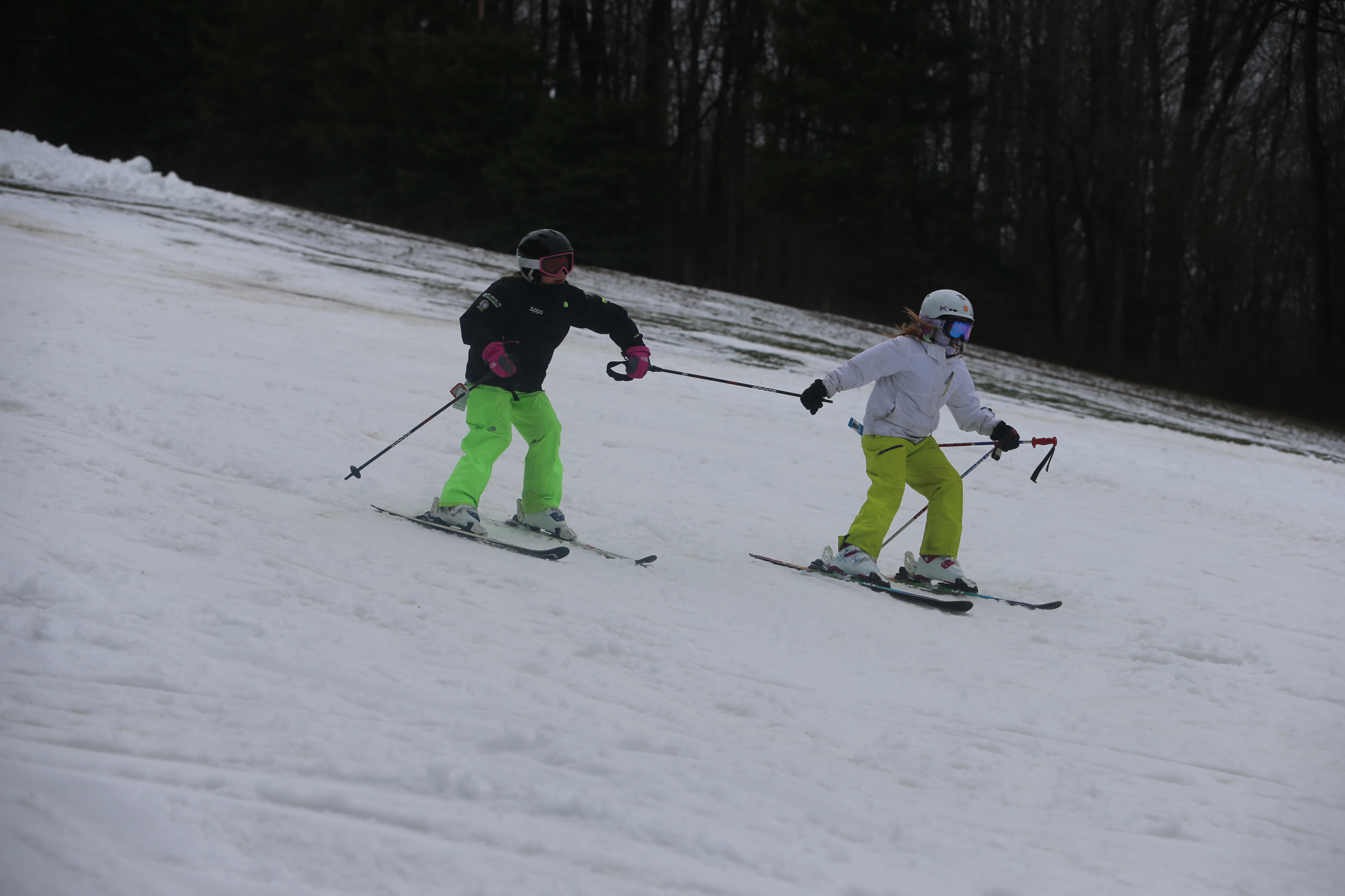 Skiers share a pole as the go down Mardi Gras on opening weekend at Holiday Valley in Ellicottville,. (John Hickey/Buffalo News)