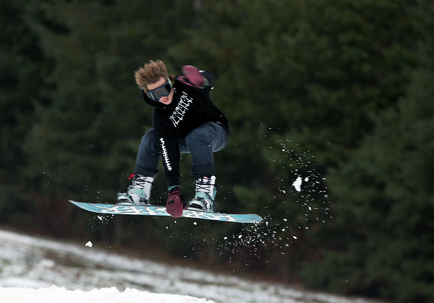 Snowboarder Jake Lamb, 17, of Grimsby, Ontario hits a jump on Mardi Gras as snowboarders and skiers hit the slopes on opening weekend Holiday Valley, they had 4 chairlifts and 5 slopes open, in Ellicottville, N.Y., on Sunday, Nov. 27, 2016. (John Hickey/Buffalo News)