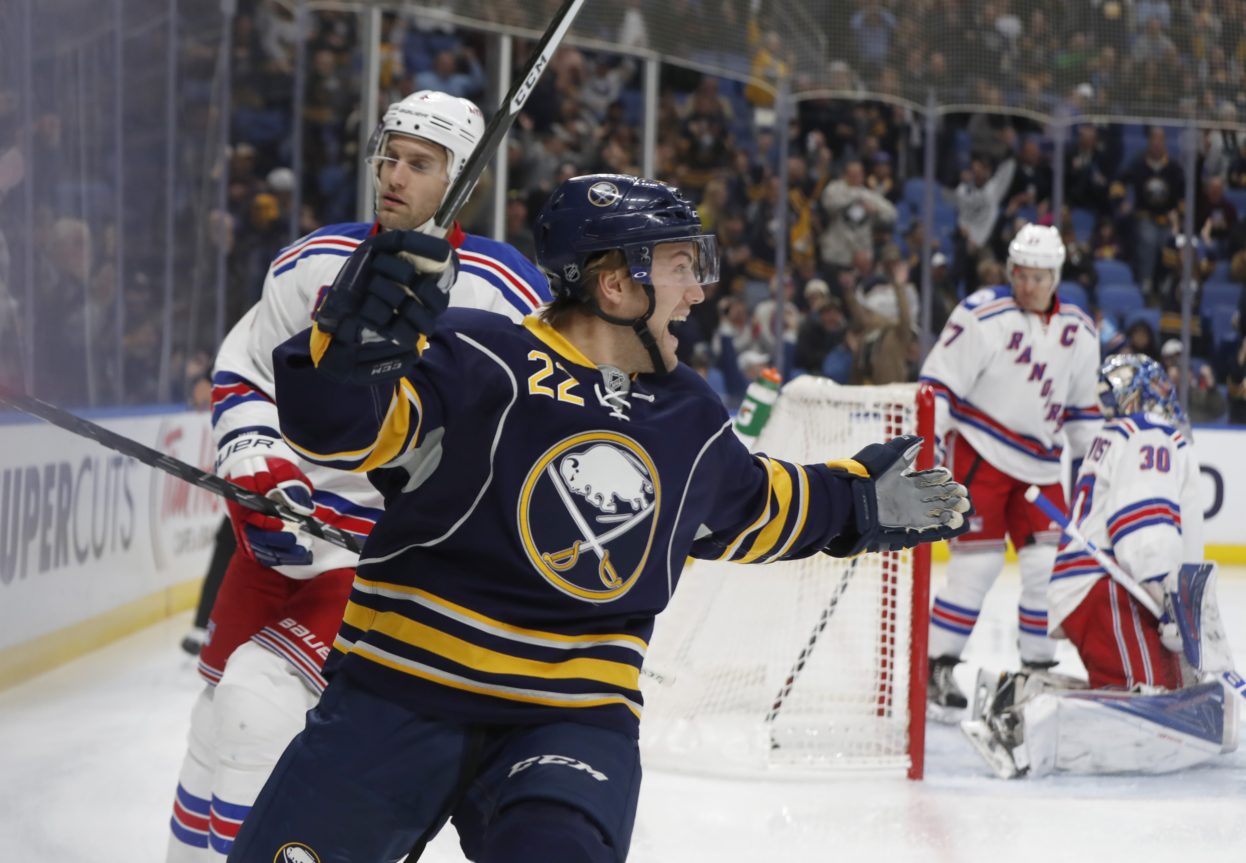 Johan Larsson reacts with excited disbelief after Buffalo scores just 18 seconds into the game. (Harry Scull Jr./Buffalo News)