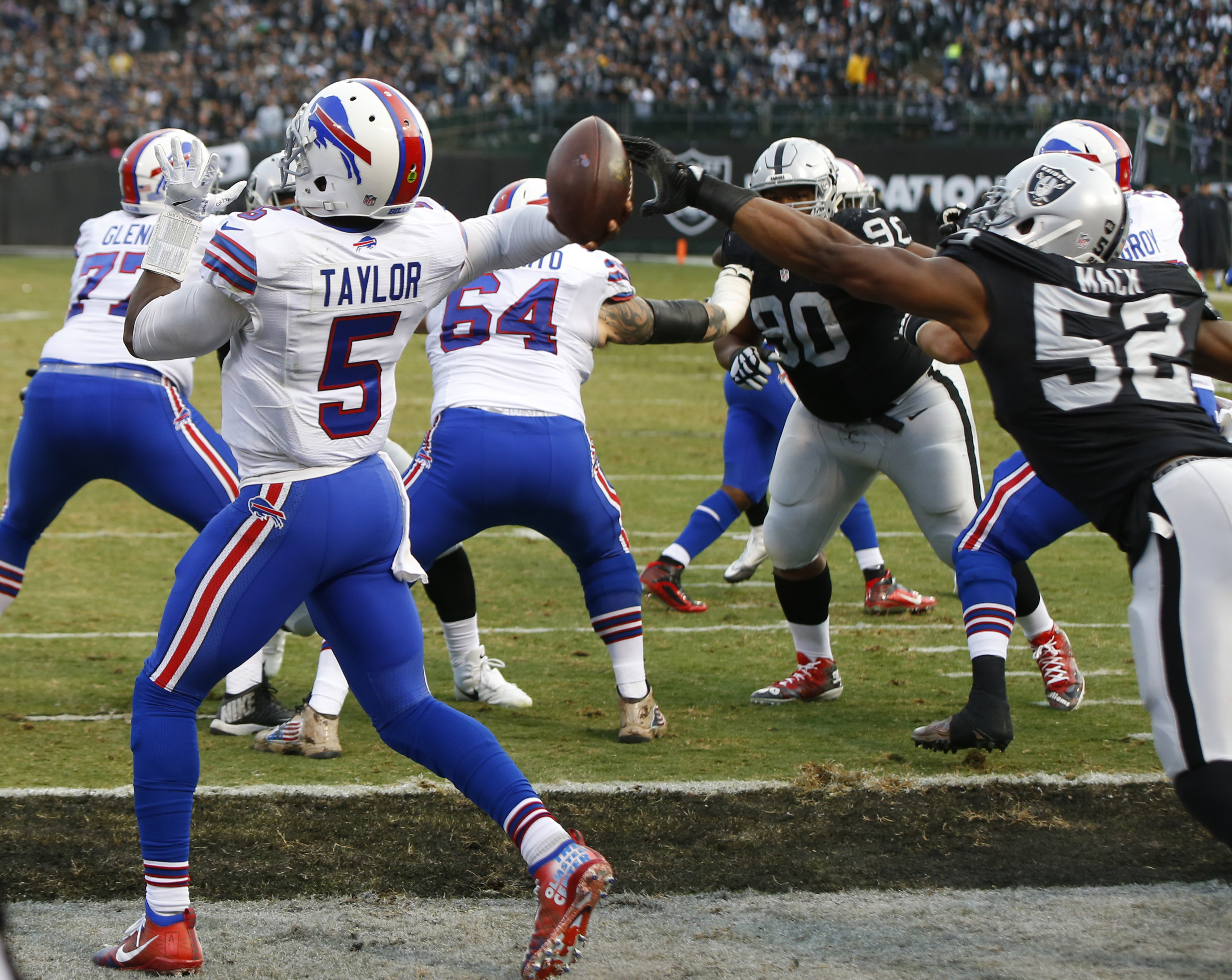 Buffalo Bills quarterback Tyrod Taylor has the ball tipped by Oakland's Khalil Mack in a huge play in the fourth quarter. (Harry Scull Jr./Buffalo News)