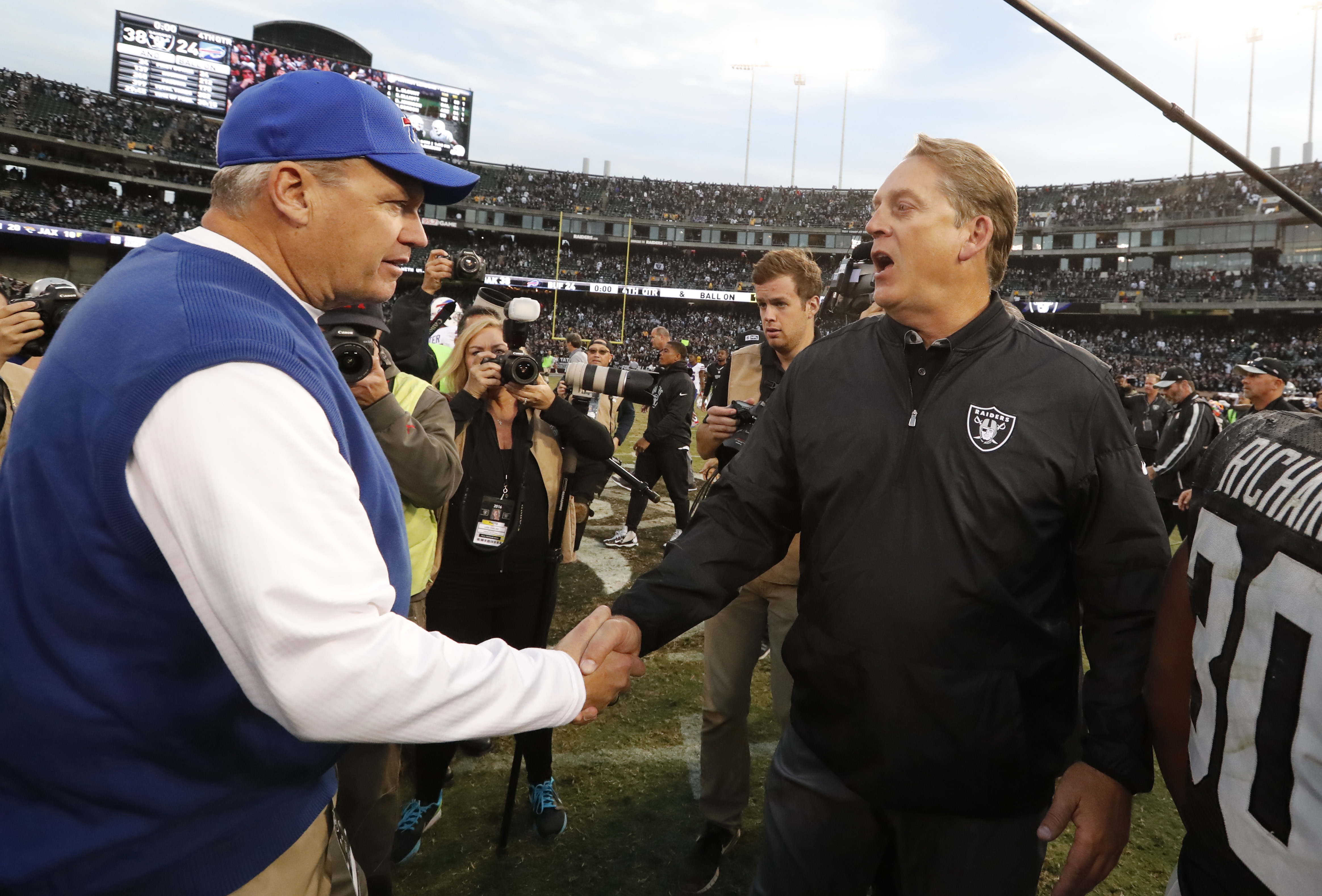 Buffalo Bills head coach Rex Ryan and Oakland Raiders head coach Jack DelRio shake hands after a Raiders win Sunday. (Harry Scull Jr./Buffalo News)
