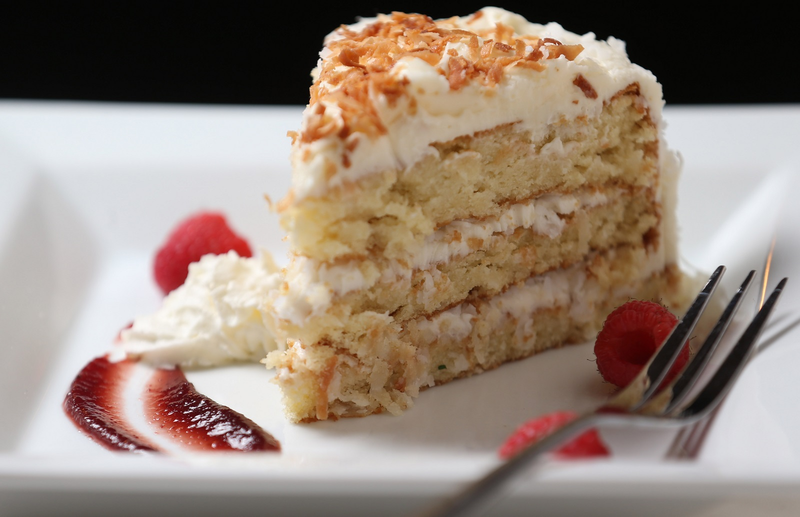The coconut cake is topped with coconut cream frosting. (Sharon Cantillon/Buffalo News)
