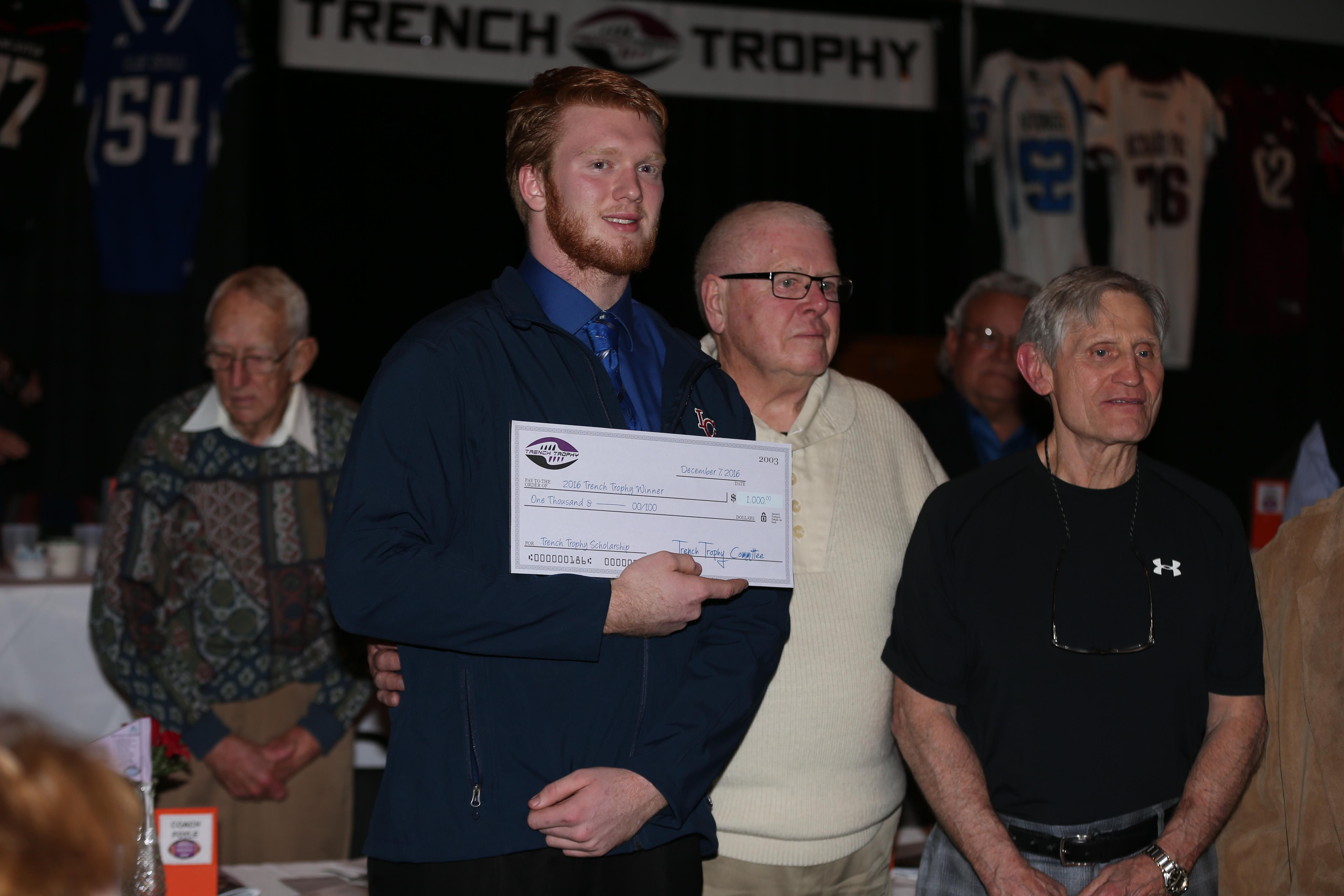 Nathan Emer of Iroquois wins the Trench Trophy at Lancaster Elks Lodge on Wednesday.  (James P. McCoy/Buffalo News)