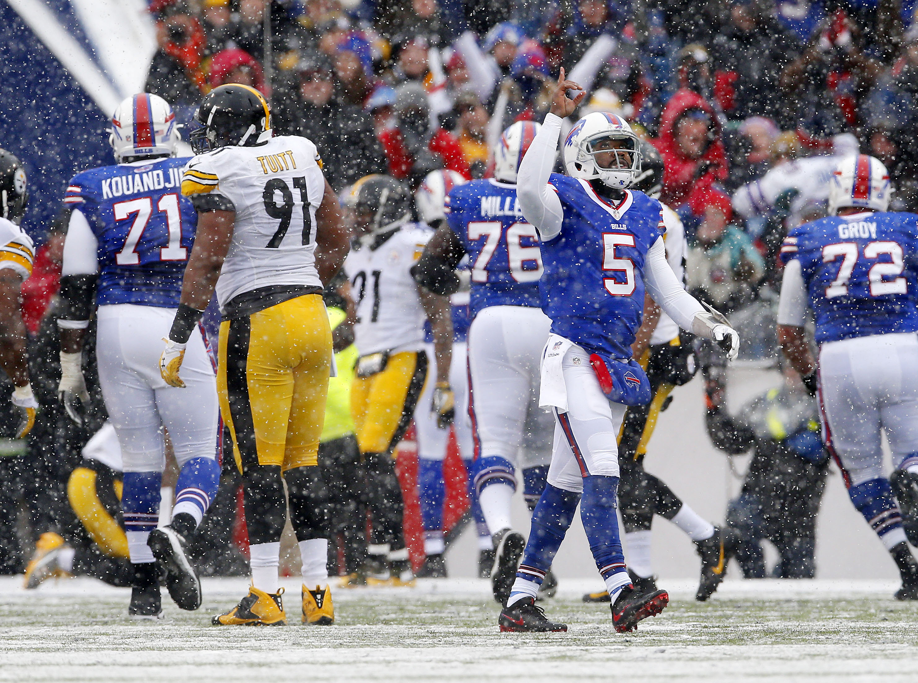 The Bills Tyrold Taylor celebrates throwing a touchdown pass to Sammy Watkins in the second quarter. (Mark Mulville/The Buffalo News)