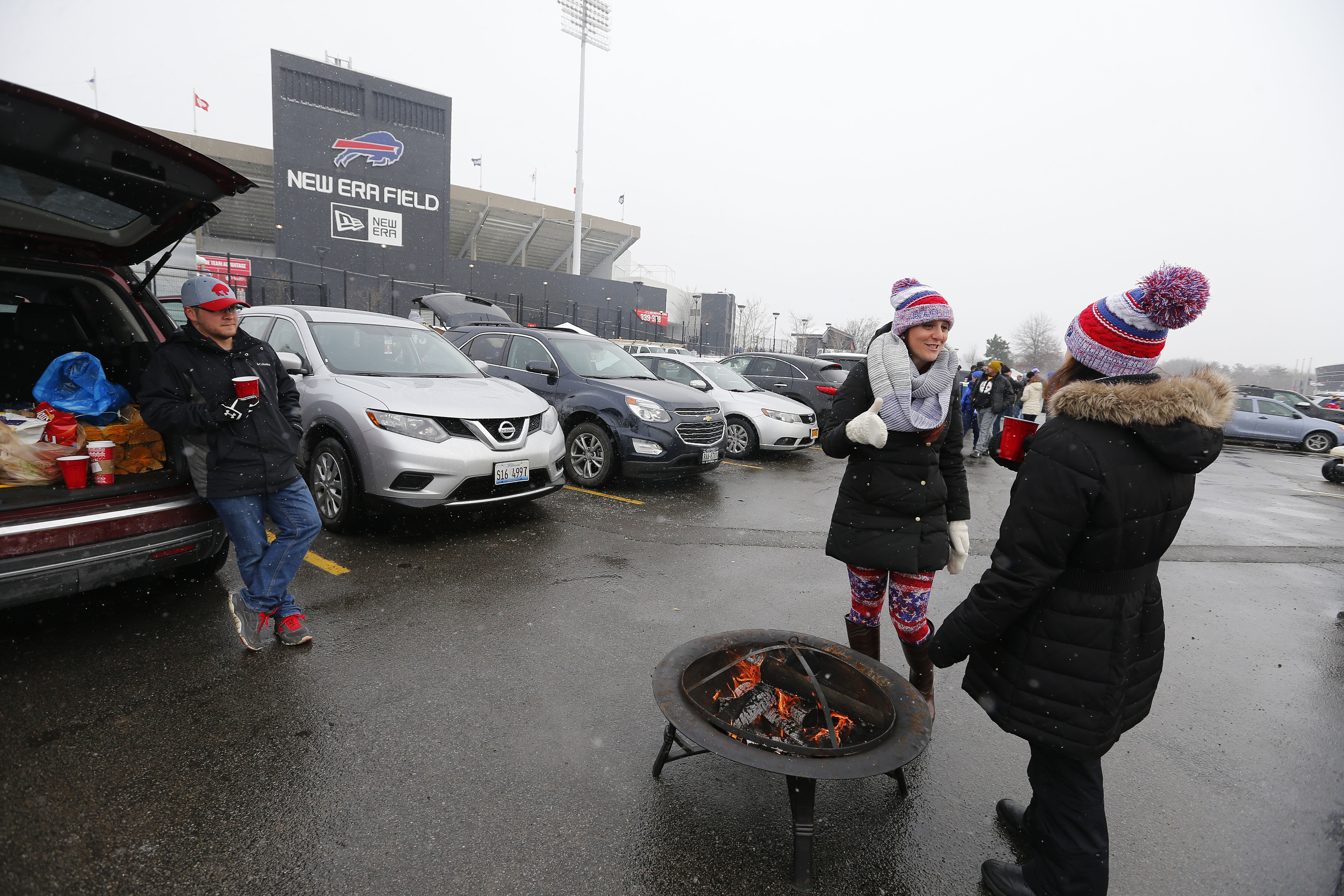 Matt Carlucci, left, Margaret Carlucci, center, and Diana Robbins, right, tailgate before the game with the Steelers at New Era Field in Orchard Park Sunday, December 11, 2016.    (Mark Mulville/The Buffalo News)