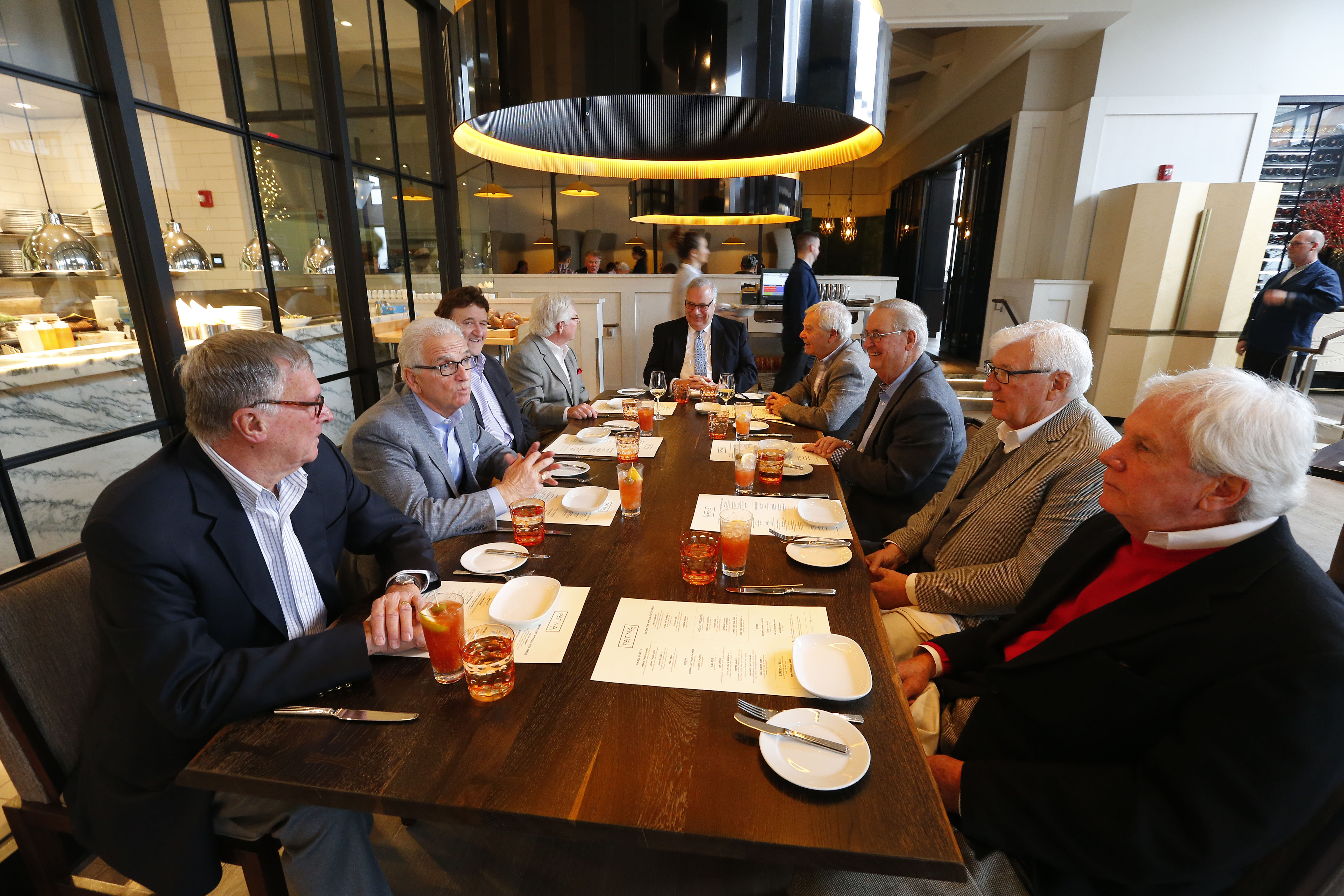 The Monday Lunch Crew, from left to right: Walt Jaros, Sam Gullo, Roger Pasquarella, Karl Puzio, Hon. Joseph Fiorella, Fred Occhino, Frank Kopfer, Jim Harrity and Dennis Dargavel, enjoy some conversation at Patina in Buffalo Monday, Dec. 12, 2016. (Mark Mulville/Buffalo News)