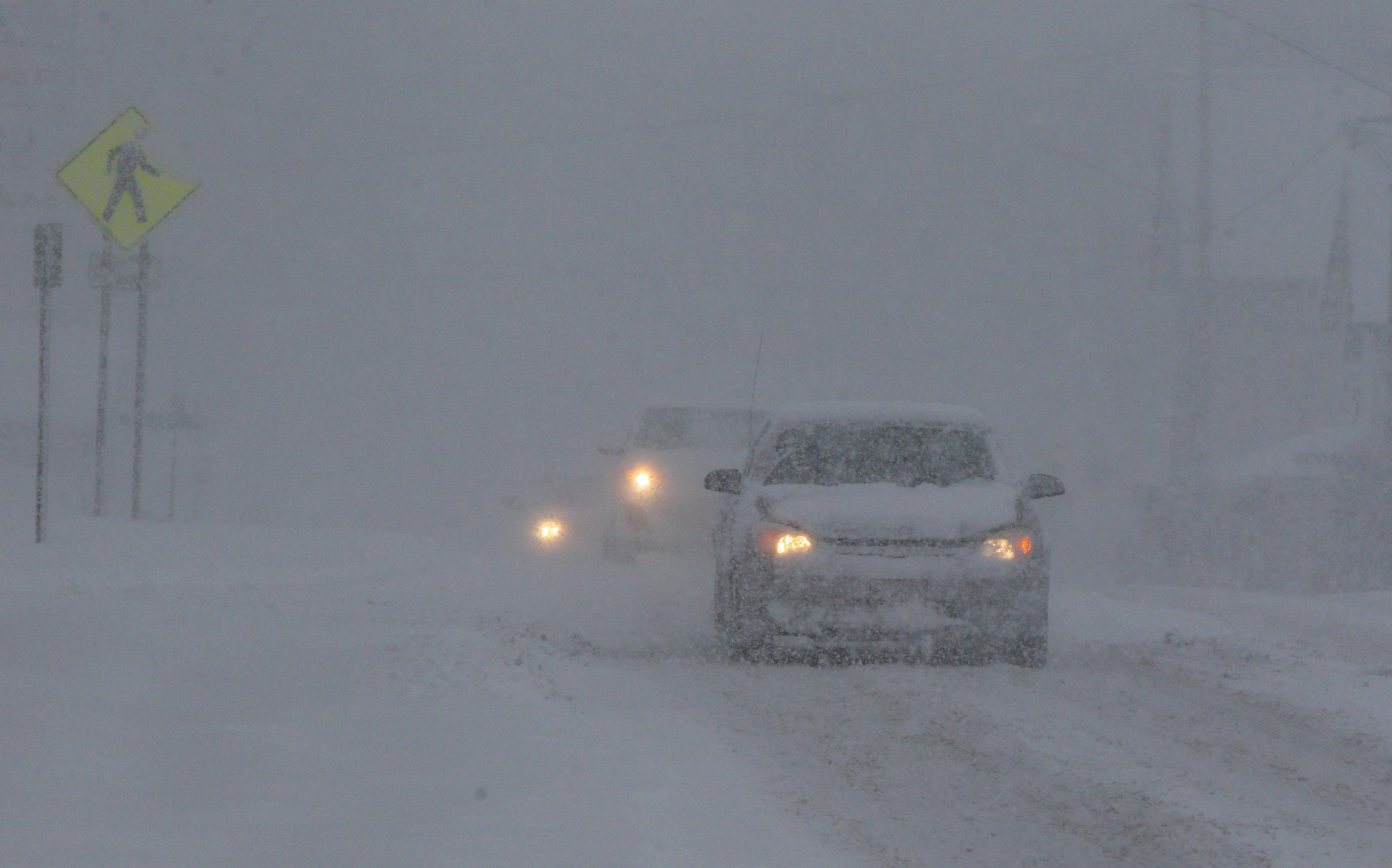 Falling snow makes the travel slow on Main Street in Springville on Thursday, December 8, 2016.    (Mark Mulville/The Buffalo News)