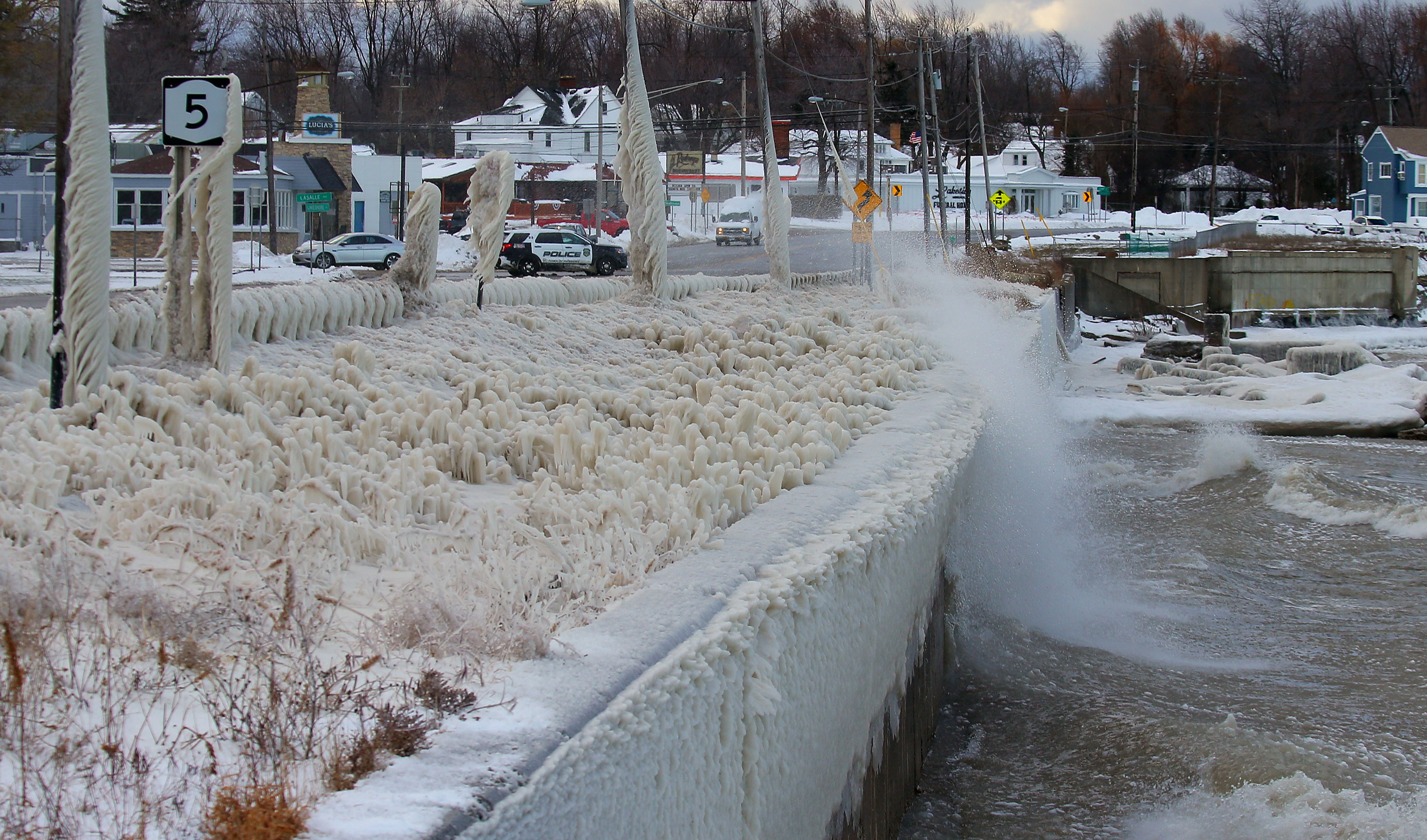 Wind drives lake water up onto Route 5 in Hamburg on Dec. 15. The wind direction in forecast data Monday was Don Paul's first clue that we might be due for lake-effect snow this week. (John Hickey/News file photo)