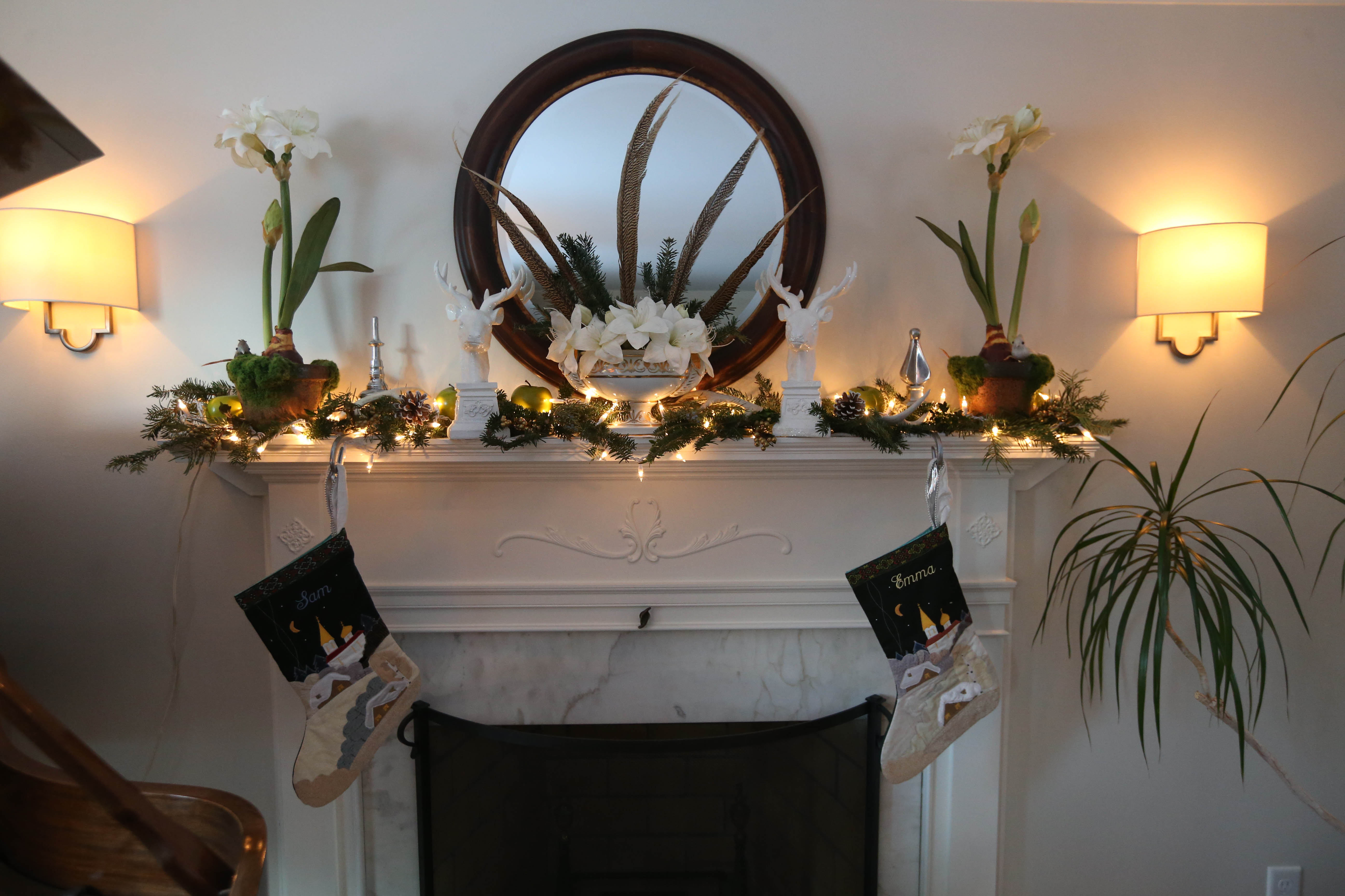 The fireplace mantel in the living room is decorated in ivory, greens and touches of metallics. Photo by Sharon Cantillon/Buffalo News.