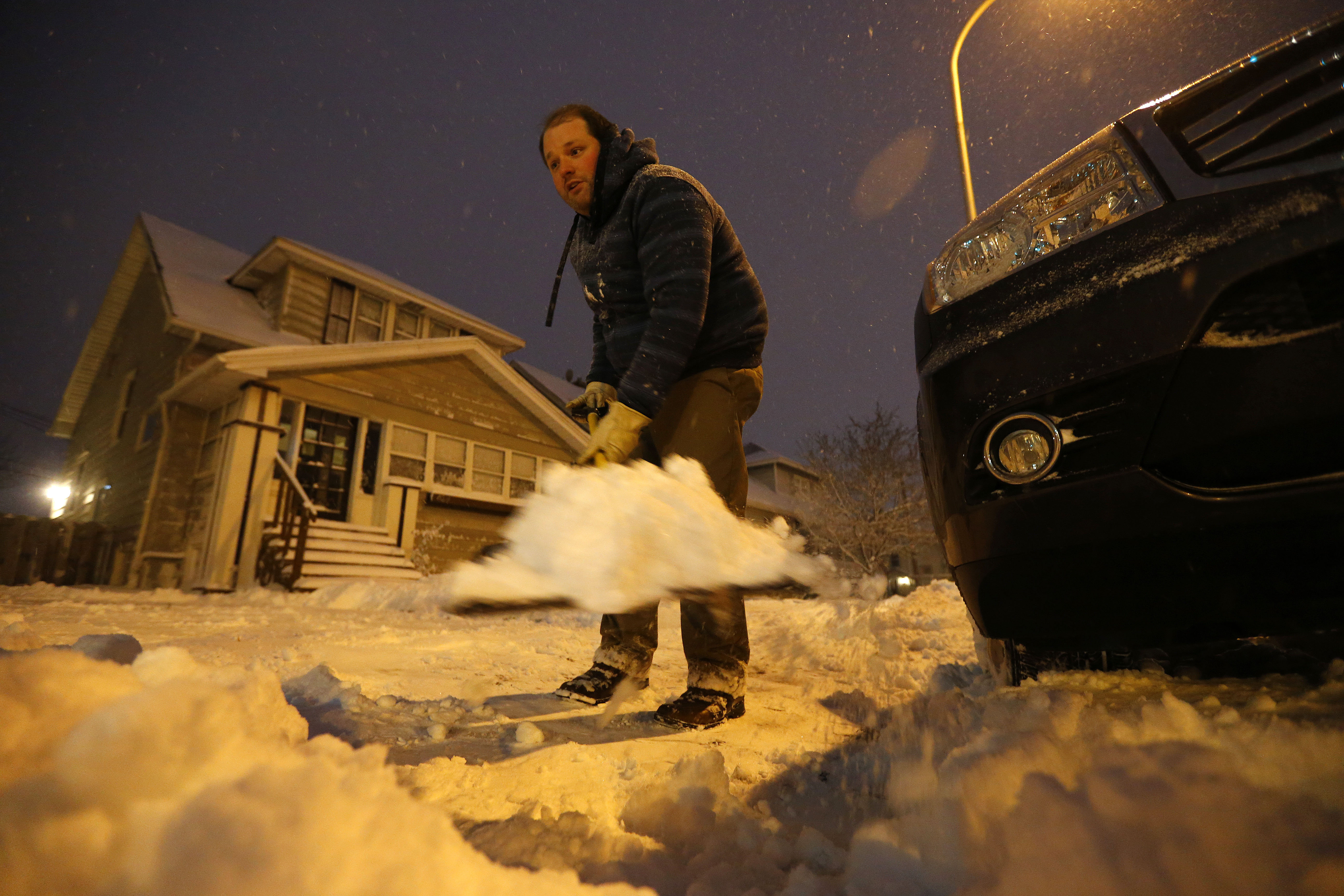 Evan Leigh shovels his driveway on Abbott Road in South Buffalo on Wednesday, Dec. 14, 2016.(Mark Mulville/Buffalo News)