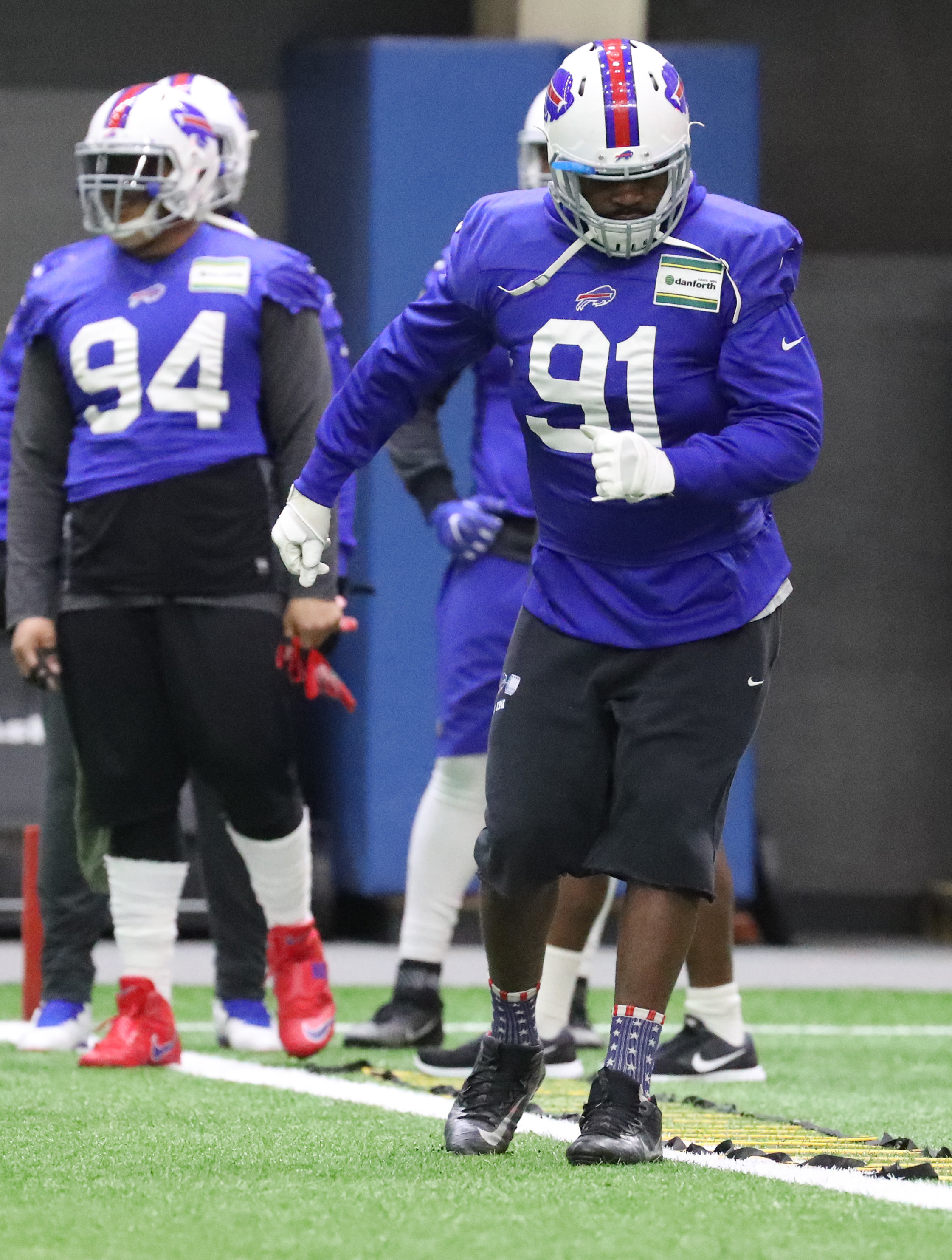 Former Bills defensive end Leger Douzable, right, reportedly was one of three free-agent defensive linemen making a free-agent visit to the team Monday. (James P. McCoy/Buffalo News)