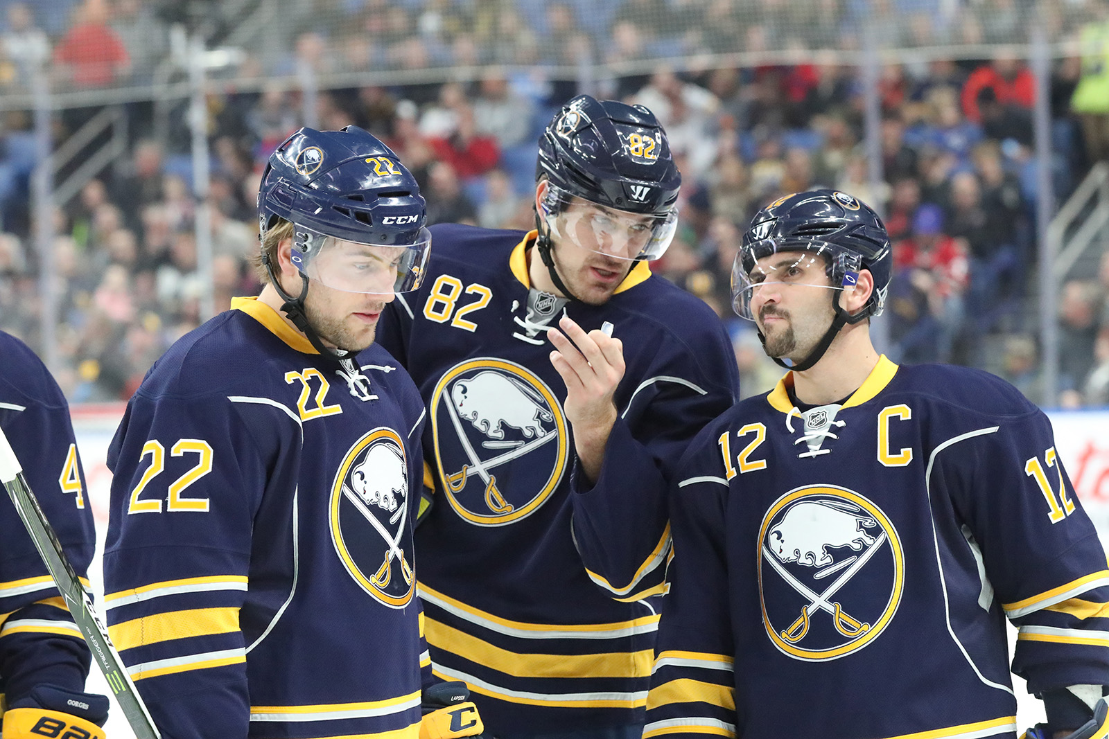 The line of Johan Larsson, Marcus Foligno and Brian Gionta created the first Sabres goal. (James P. McCoy/Buffalo News)